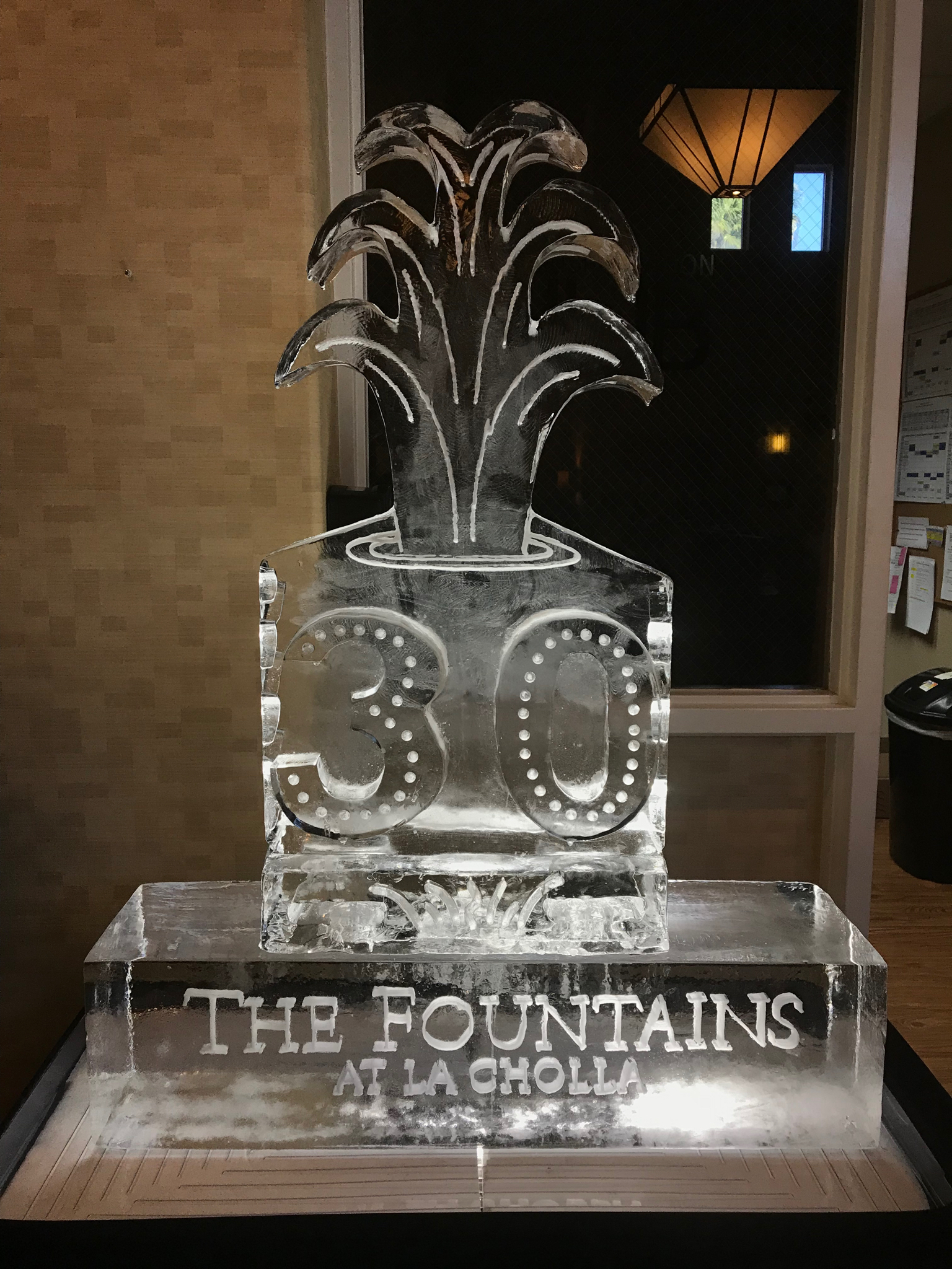 "Company logo and their anniversary year artfully captured on a block of ice, 40"" X 20"""