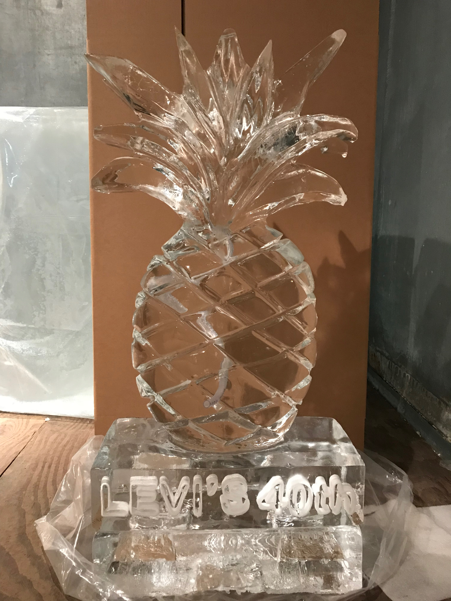 Offering a tropical twist to the event, this pineapple is an example of the different types of drink luges that we can create. Snow inlay engraving identifies the event.