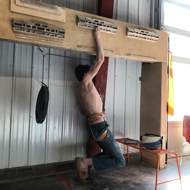"""A-Member @houtz2 in for another early morning hangboard sesh. """"Try not to get the 45lb weight in the shot Zach. I don't wanna look like a [weak guy] on the Internet"""". #yousucktryharder"""