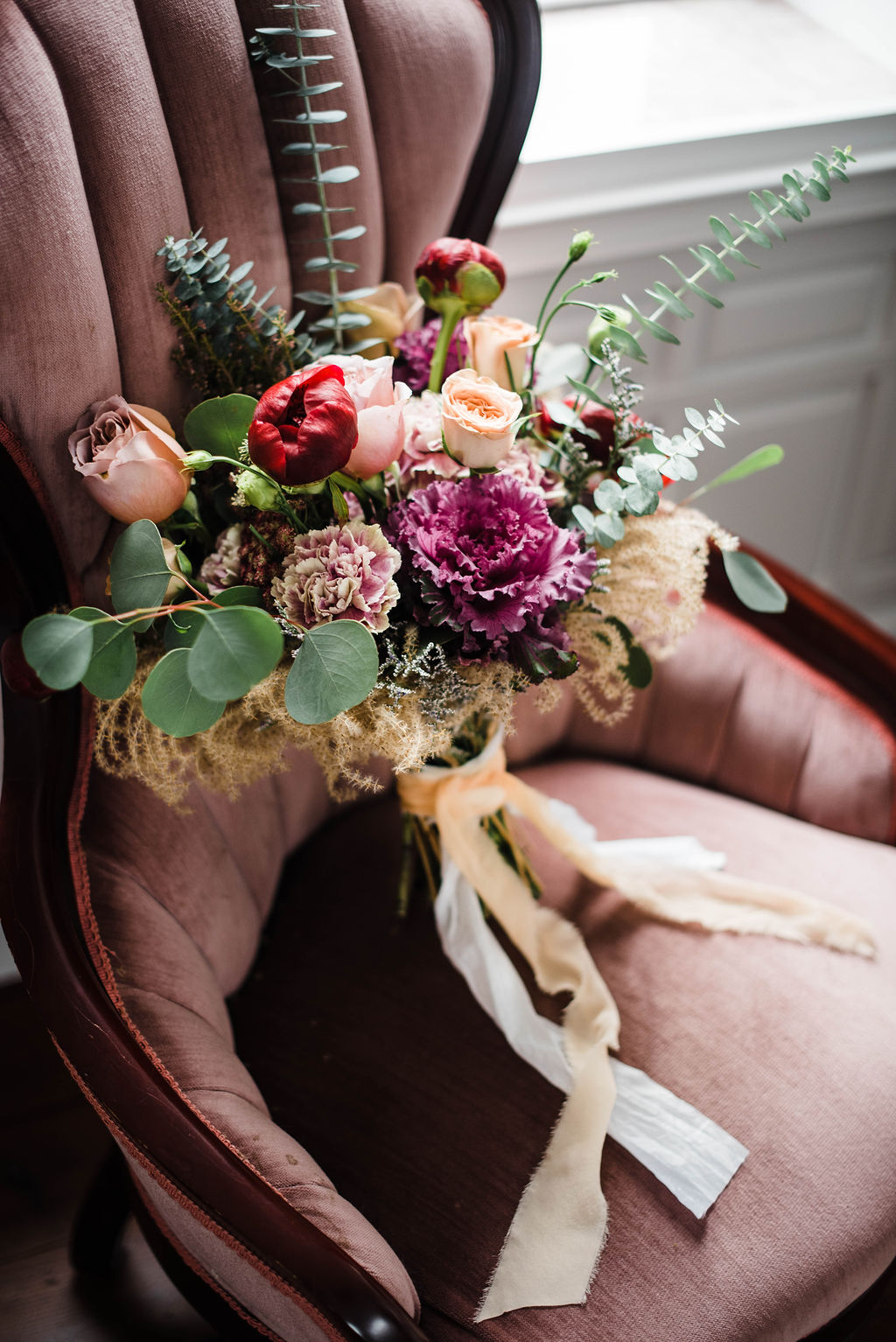 A moody, overcast day at Belle Garden Estate called for lush jewel-toned florals to offset the leather details in this styling. The pink kale and pampas grass offer unique variety in texture alongside the wine peonies and eucalyptus. #floraldesign #weddingflorals #weddingflowers #virginiawedding #virginiabride #virginiaflorist