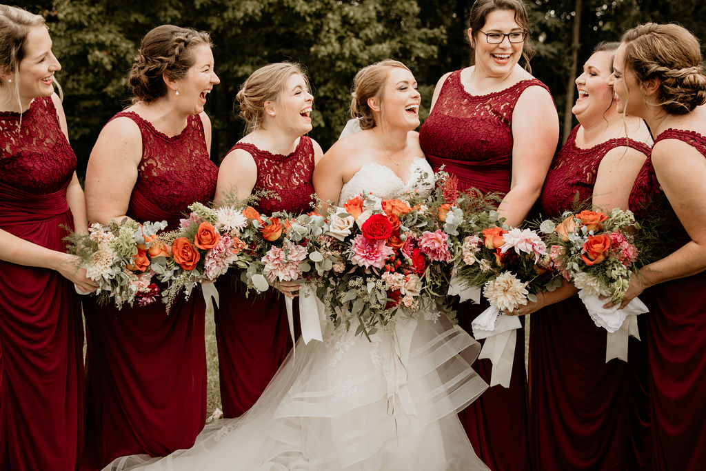 Katelyn lives life out loud, and her wedding was no different. She wanted flowers to be a major part of her wedding day, including a lush floral wall, a cake draped in flowers, and a bouquet that was larger than life! We delivered a warm and romantic vibe filled with local dahlias and greenery. #floraldesign #weddingflorals #weddingflowers #virginiawedding #virginiabride #virginiaflorist