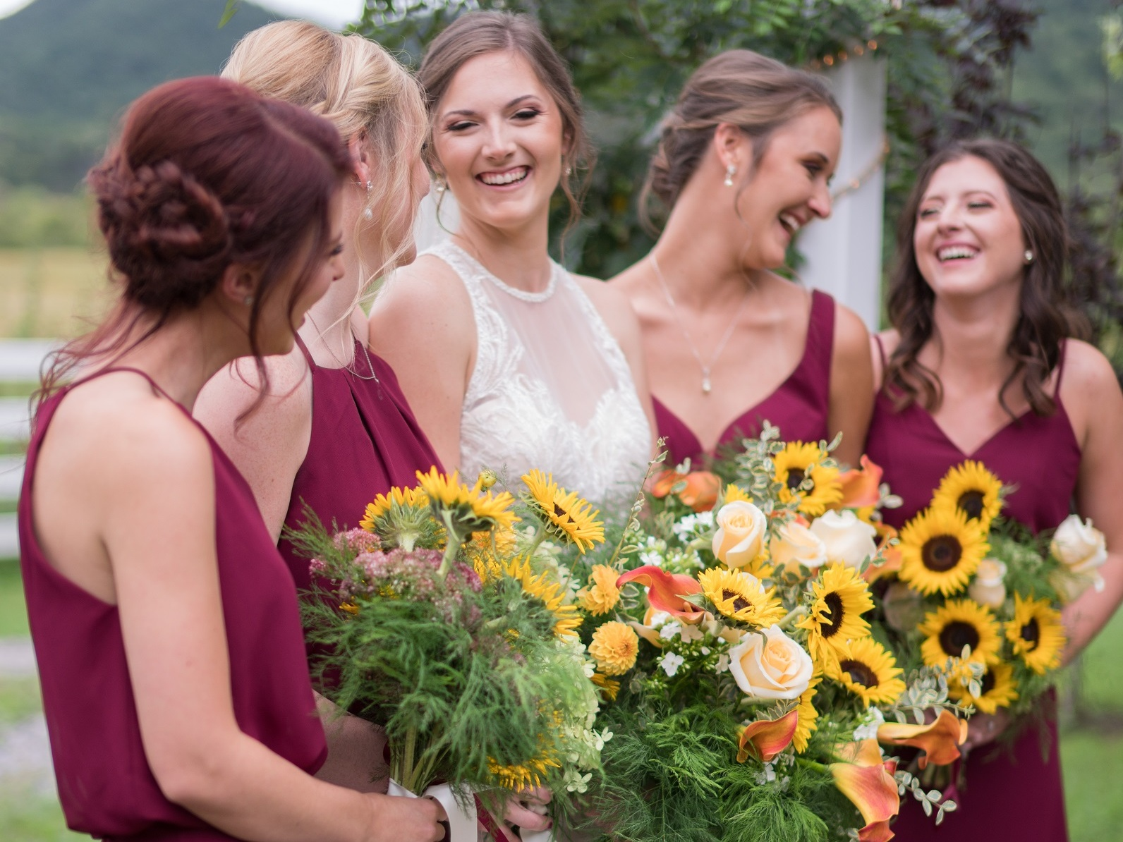 Dodging a tropical storm, this sweet couple exchanged vows outdoors beneath an arbor full of sunflowers, roses and calla lilies. We complimented the rustic reception barn with plenty of lush, local florals alongside the candlelight. #floraldesign #weddingflorals #weddingflowers #virginiawedding #virginiabride #virginiaflorist