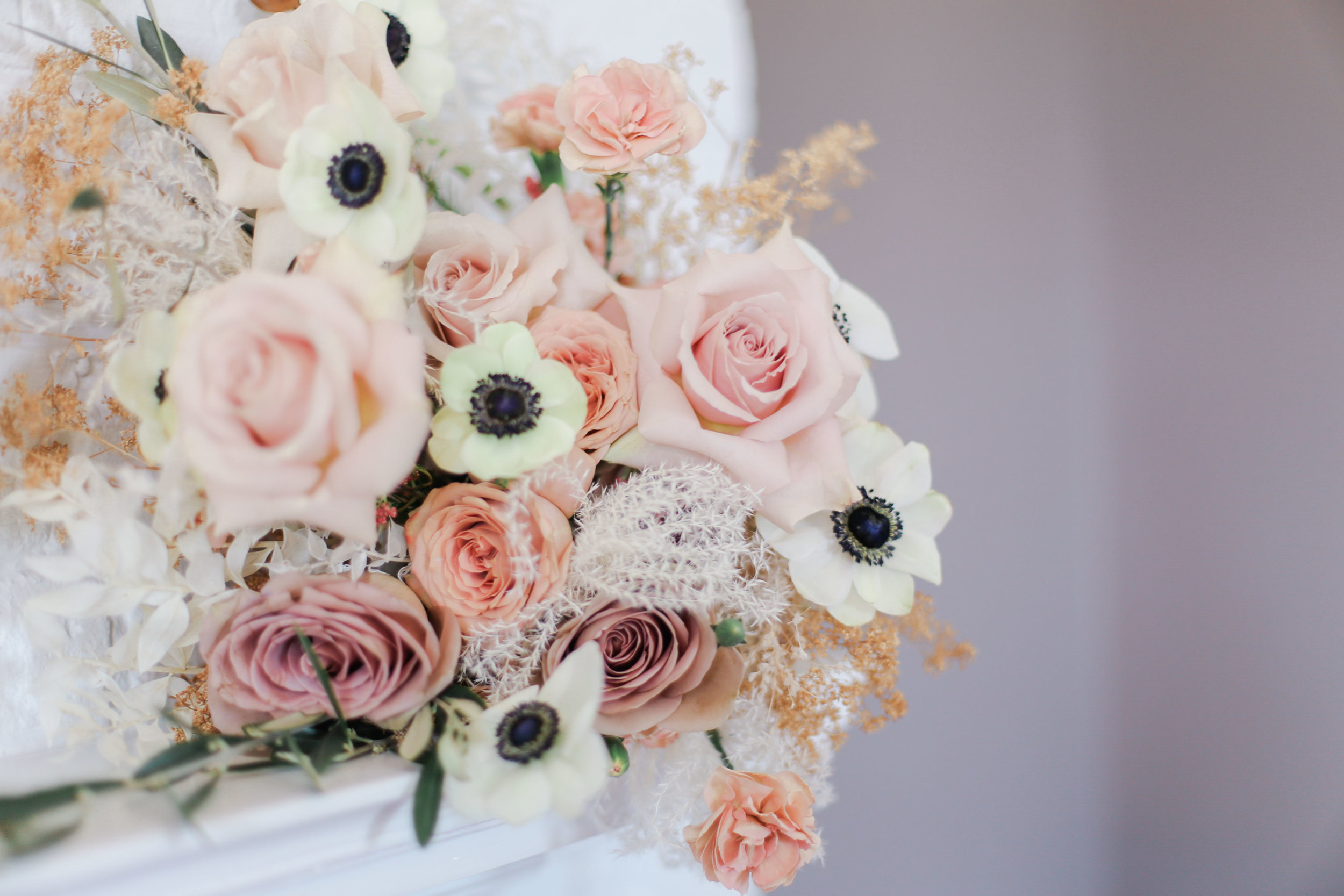 Inspired by the updated aesthetics at Belle Garden Estate, this floral design evokes spring romance and timeless class. Blush roses mix with panda anemones and dried accents to highlight variety in texture.