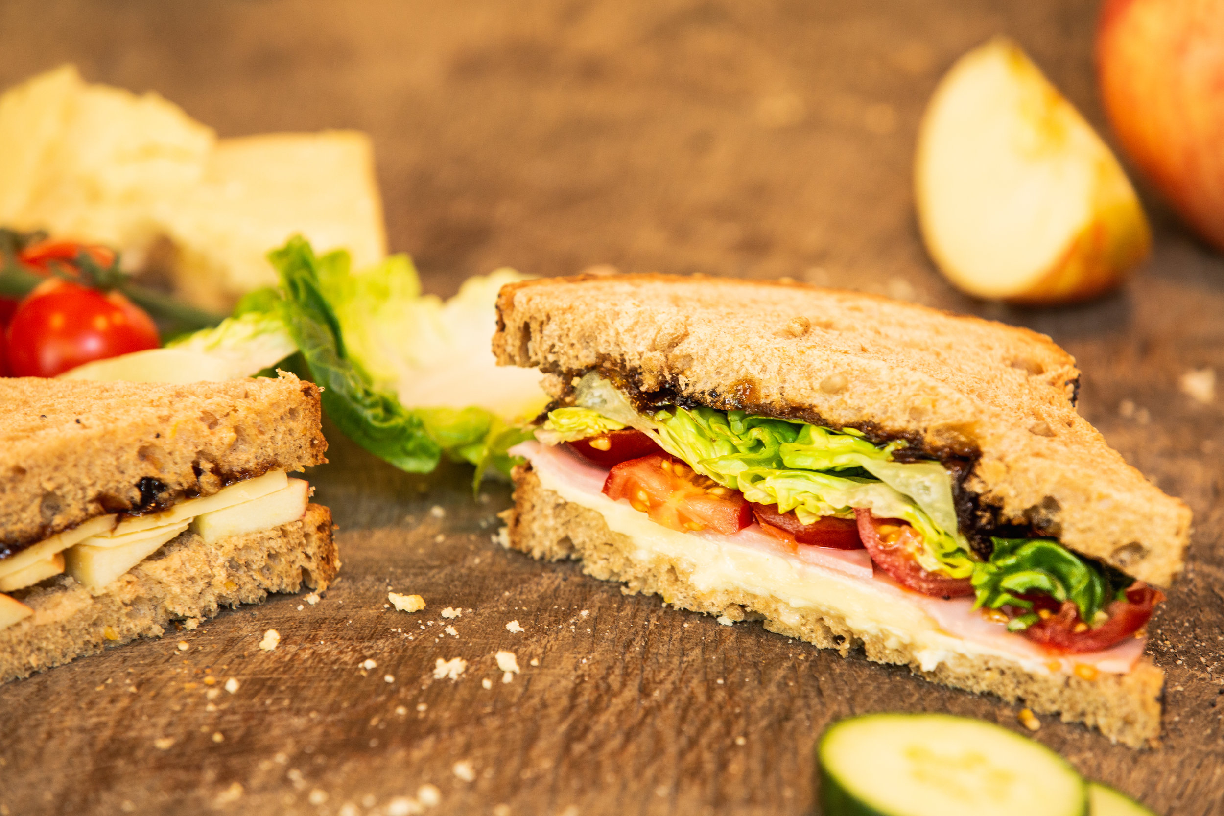 We have a range of sandwiches freshly made on site each day. This one is a Ploughman's with English cheddar cheese, ham and Tracklement's fabulous onion marmalade.