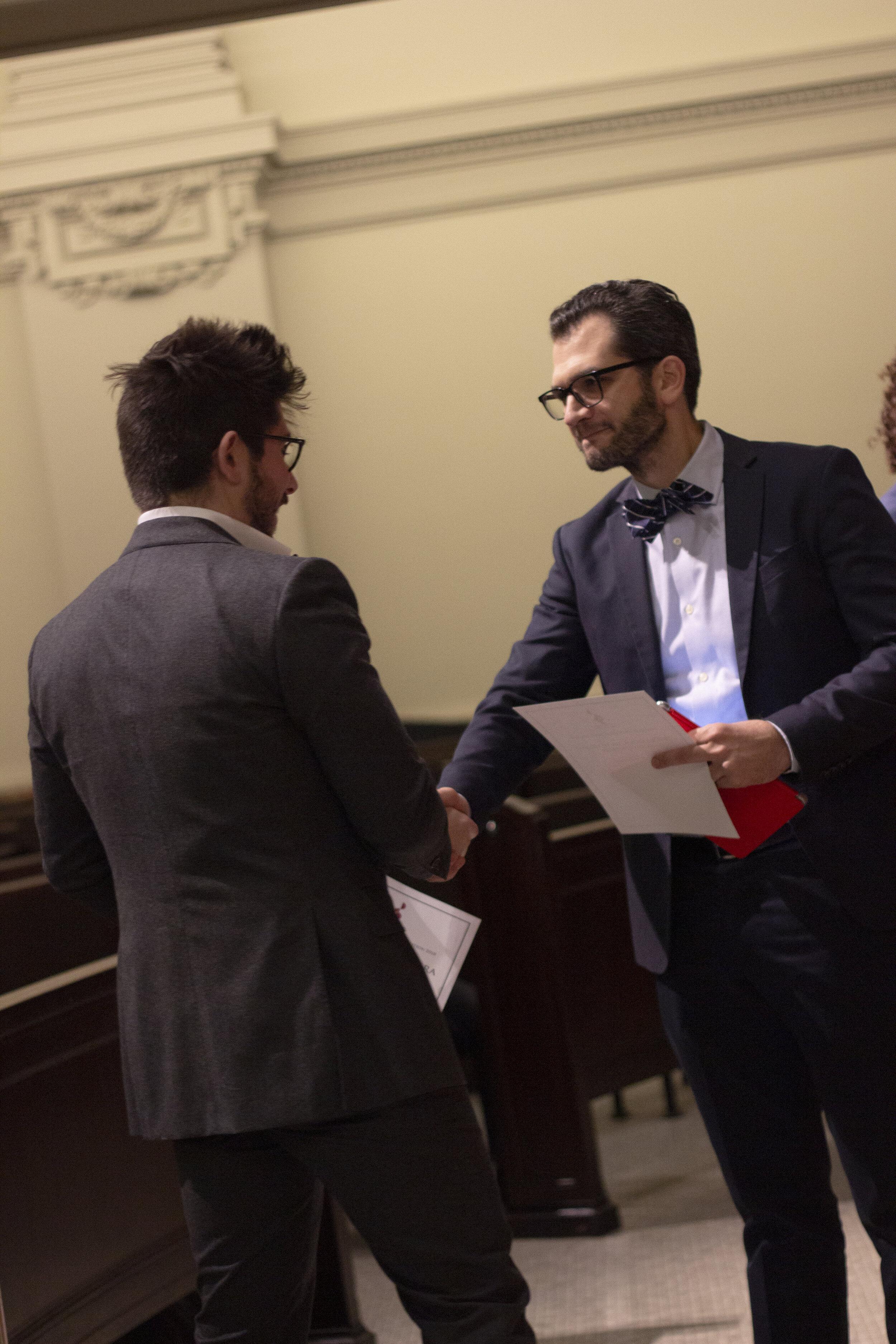 Founder, Eric Margiore presenting tenor, Mario Rojas with the Teatro Alla Scala Prize.