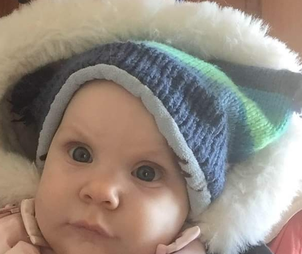 My daughter in the hat.