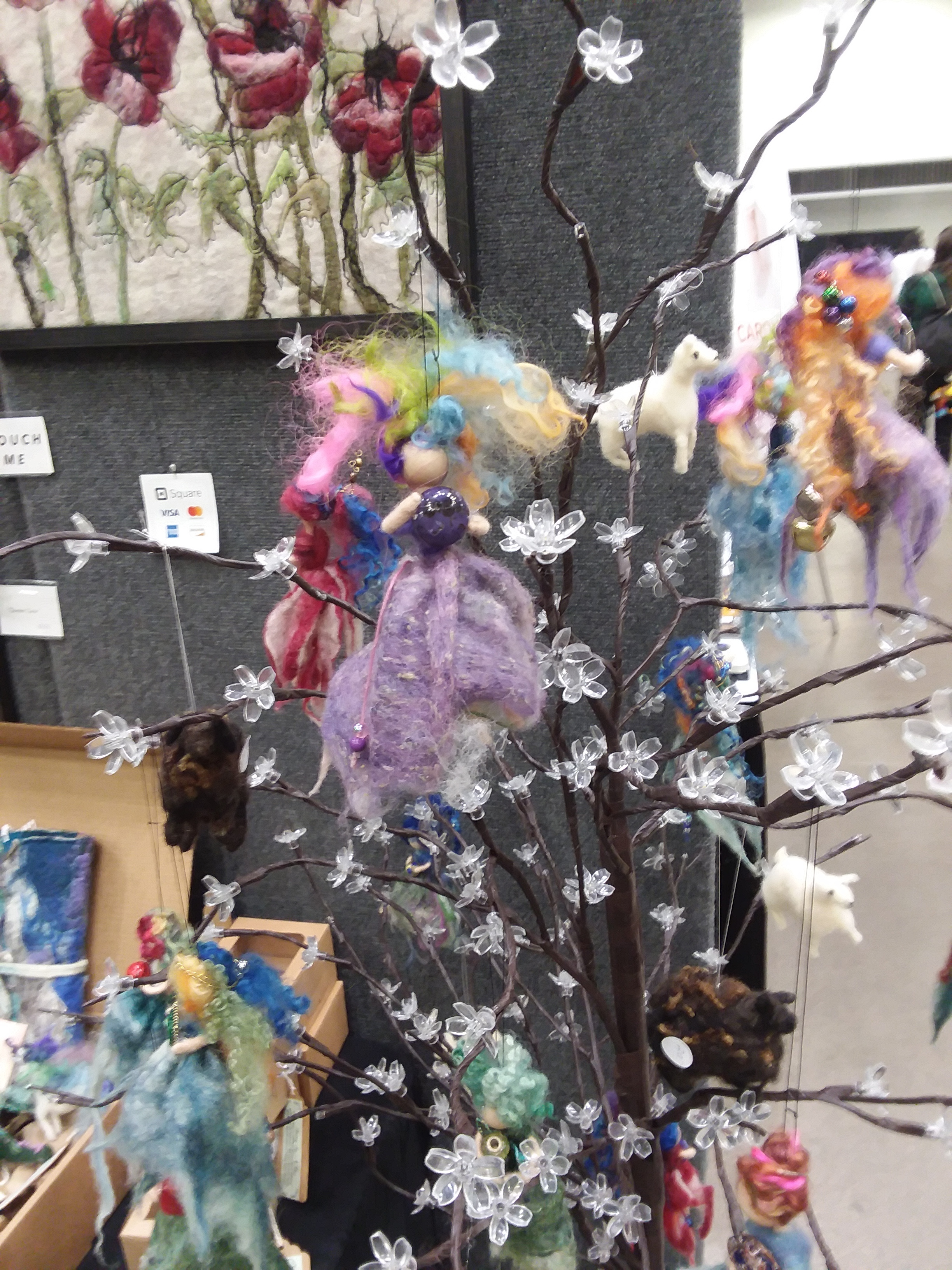 Felted fiber fairies at Anna Winette's booth.