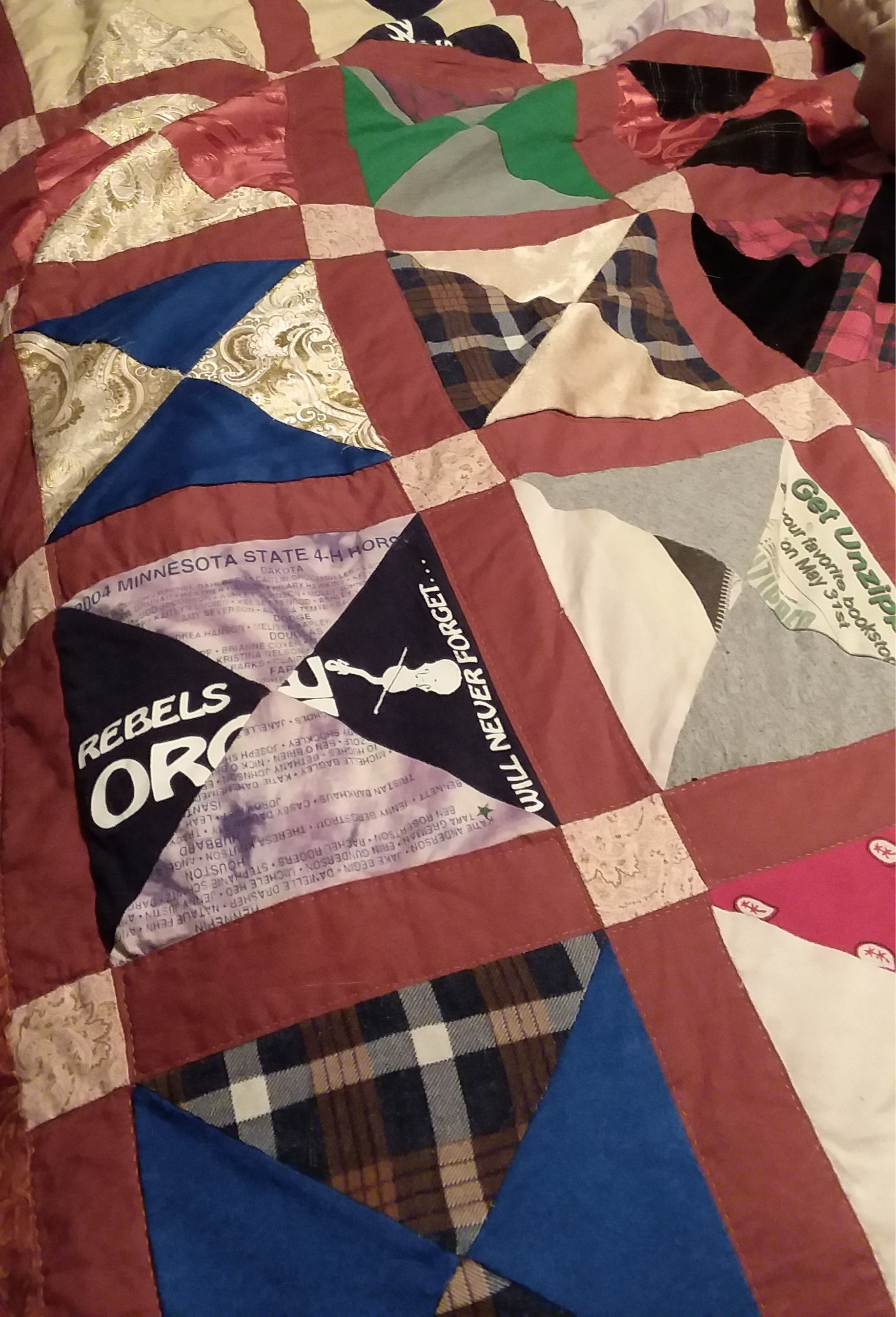 Here's the quilt that my mother took 12 years to make for me. It has scraps from my old clothes from 6 years old to high school graduation. It also has some of my dad's old shirts and fabric from my first sewing projects.