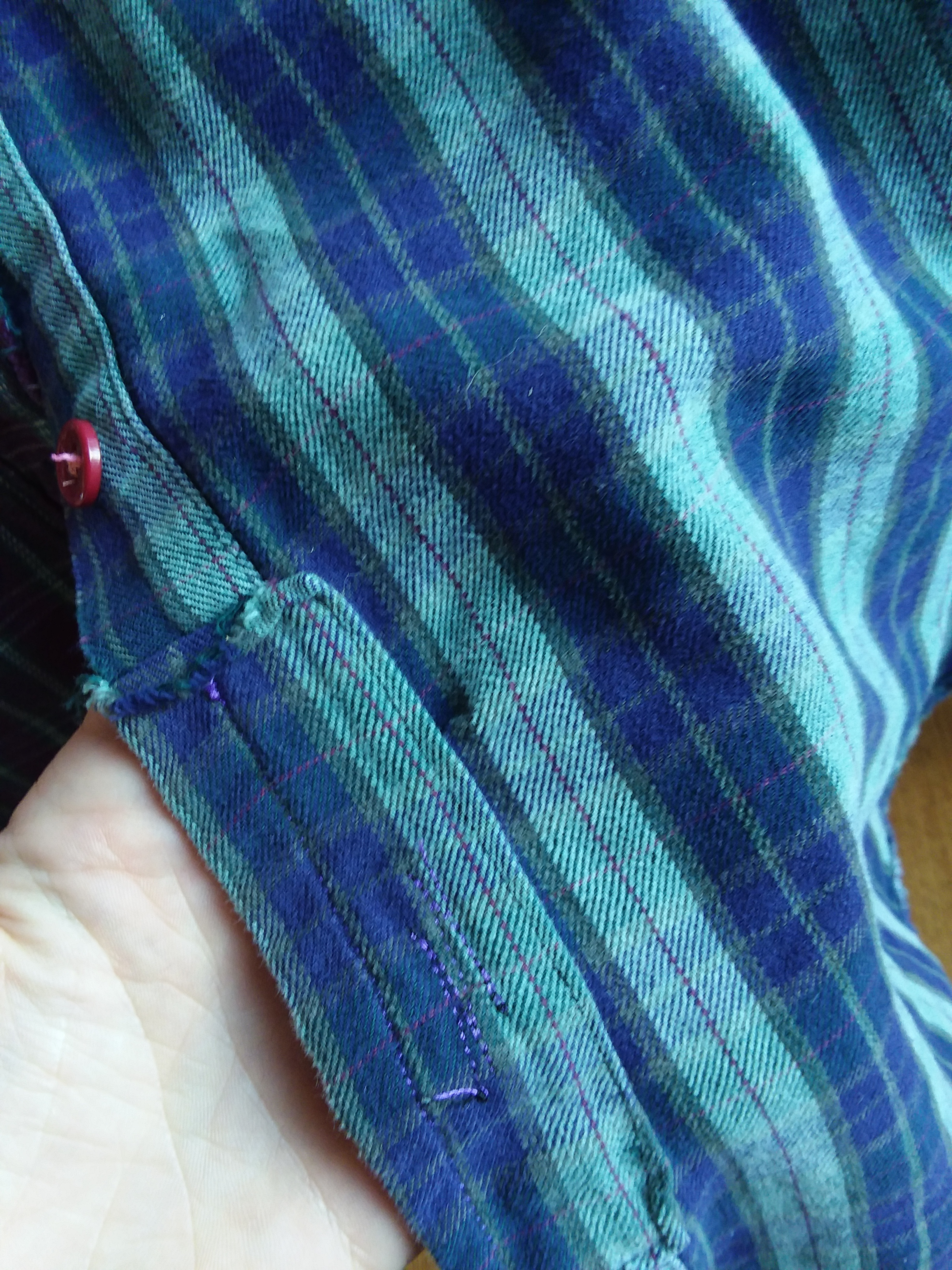 A rip on the button band was repaired with excess fabric I cut off the sides during altering.