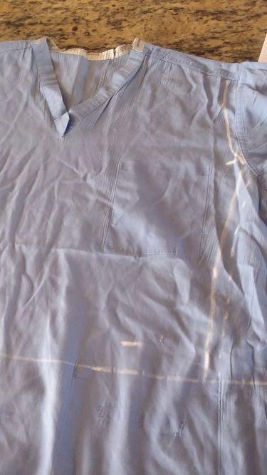 Scrub shirt with bodice drawn in.