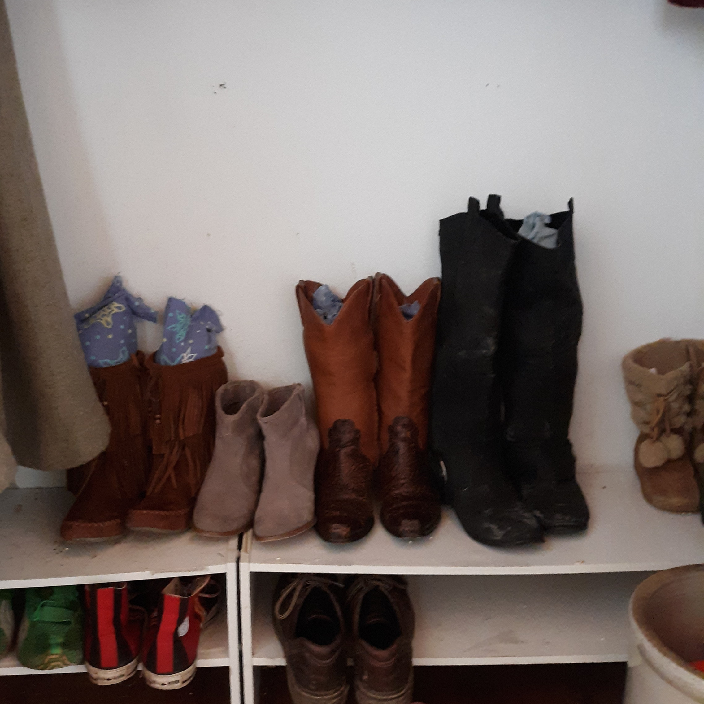 You can see the my old worn-out pajamas peeking out of the top of these boots to help them stand up.