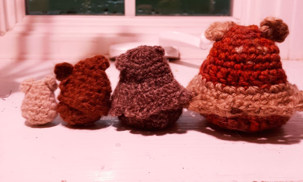 Bear family number 2. These were all made with handspun yarn. The first three are the natural color of the fiber and the biggest bear was one of my early dye attempts. The wonky looking little guy on 2nd from the left is made from my very first skein of handspun alpaca. The baby bears in both families are stuffed with wool.
