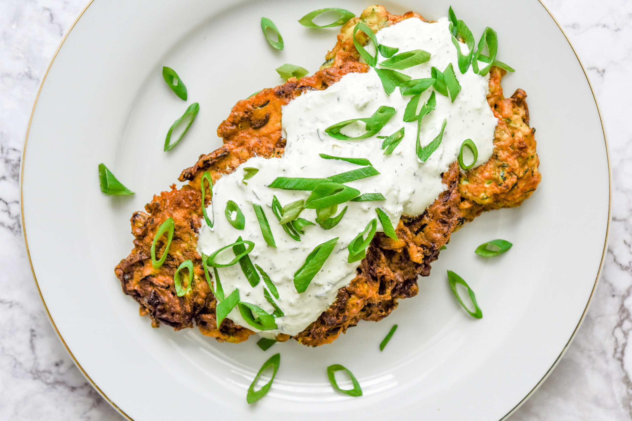 Mucver with tzatziki and scallions.