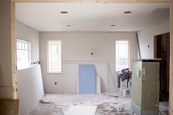 This opening was just the little door pictured below and was a bedroom, but now will be the dining room looking into the living room and we will be adding a Tudor style fireplace between those two windows!