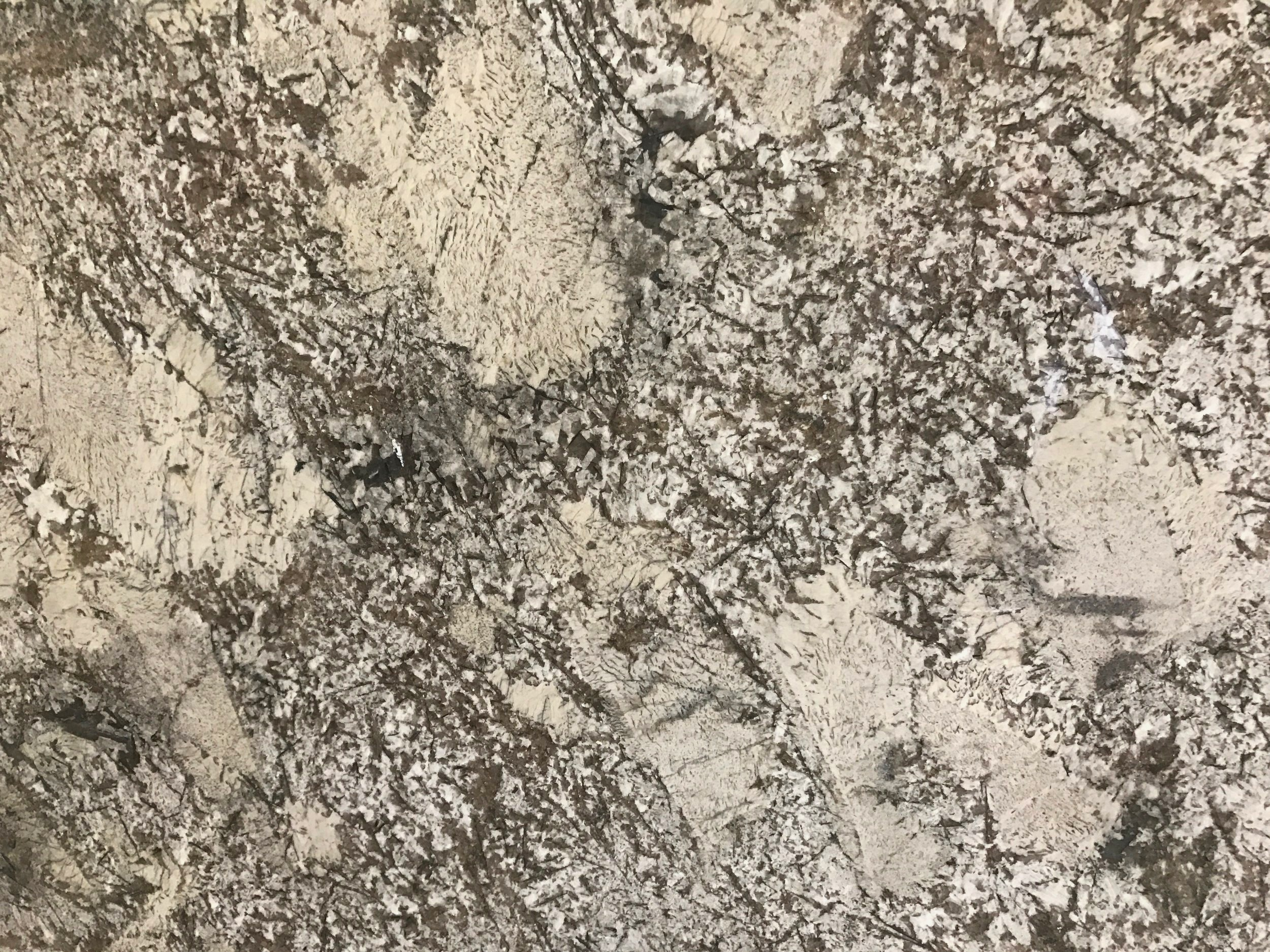 Pergaminho - Quarried: BrazilMaterial Type: GraniteDescription: light grey base color with tans, browns, and creams with silver specks throughout.Other Name(s): Crema Typhoon