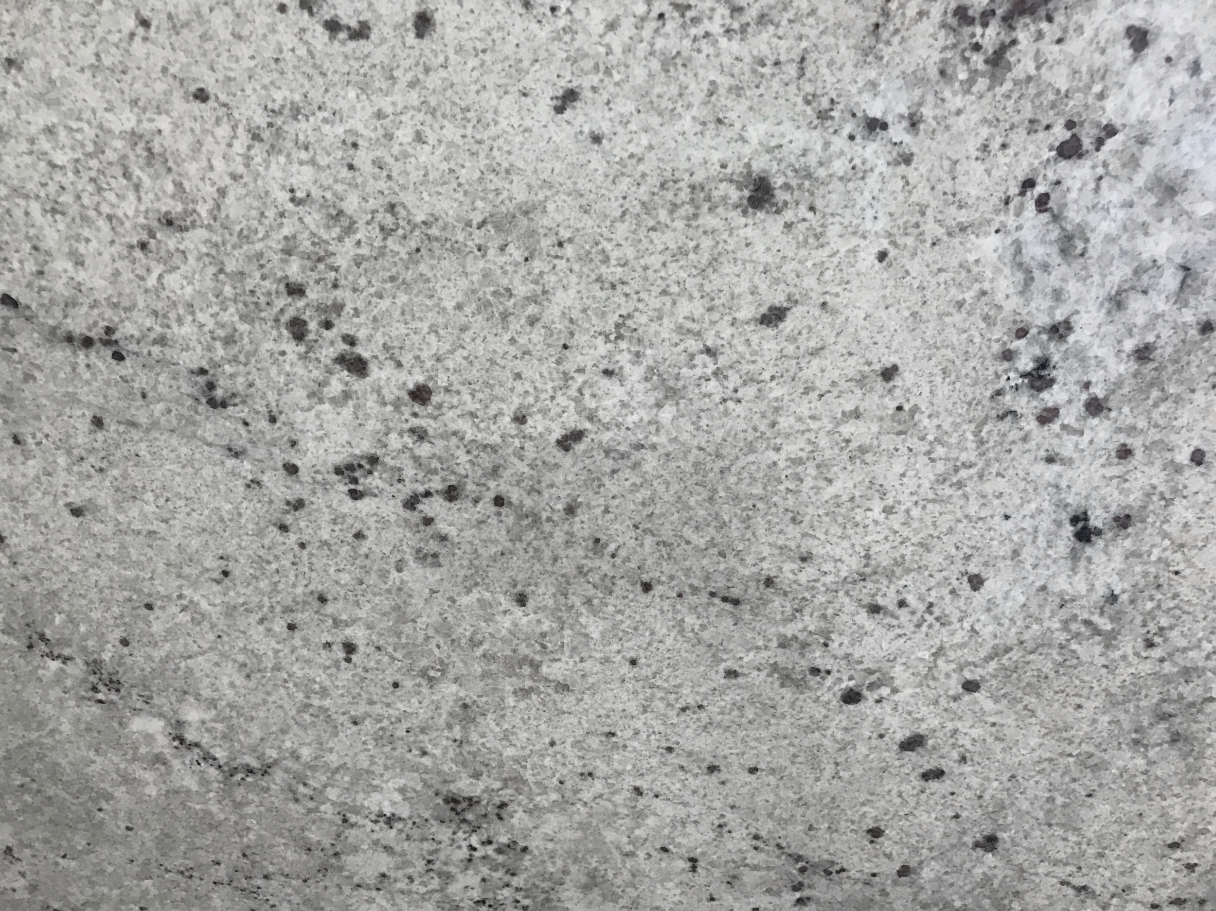 Bianco strato - Quarried: IndiaMaterial Type: GraniteDescription: white and pale grey base coloring with black and garnet specks.Other Name(s): Colonial White