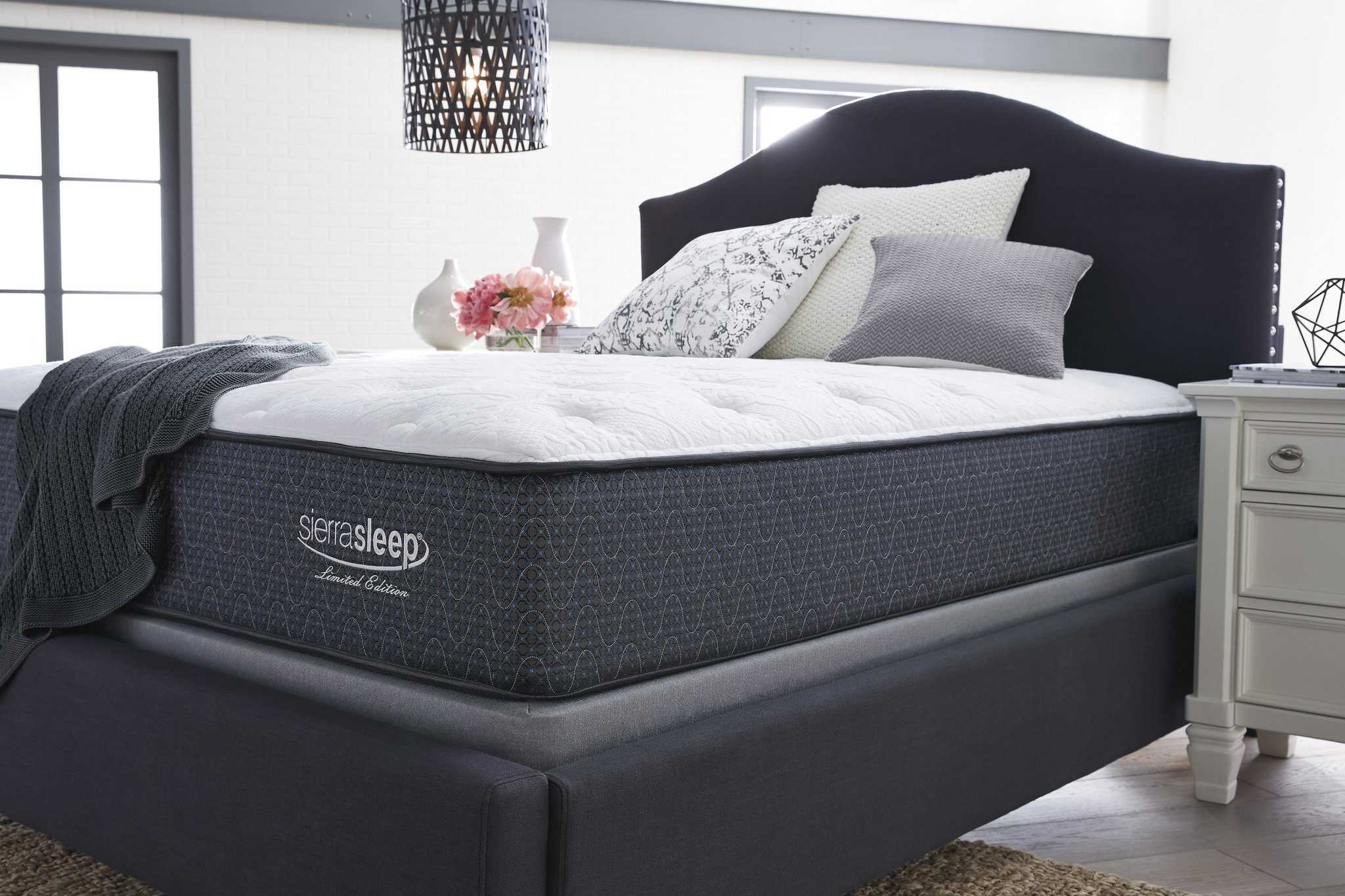 Ashley sierrasleep plush Limited edition mattress  Luxurious softness is the inevitable result of layers upon layers of high-density foam and gel support. System of 680 power packed wrapped coils offers ample structural support, while 4-way stretch knit cover provides a smooth yet durable surface for years of use.  -Ultra Loft Comfort Fiber -Blended Cotton Fiber -2 inches Luxury Support Quilt Foam -.5 inch Lumbar Gel Memory Foam -1 inch Conforma Soft Support Foam -3 inches High Density Foam Encasement -720 Encased Coils   10 Year Limited Warranty   sizes available  QUEEN, KING