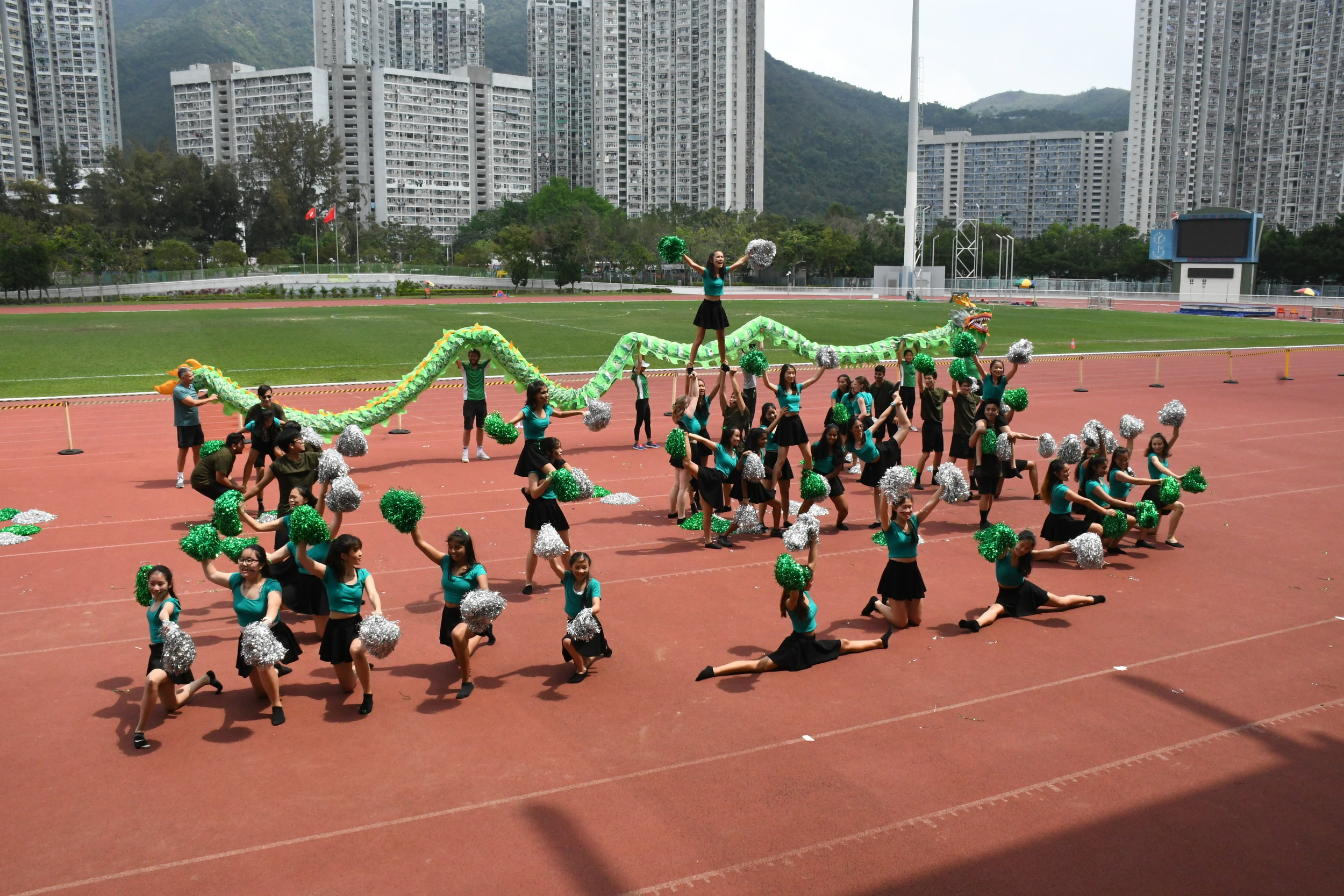 A picture of Qing House cheerleaders cheerleading