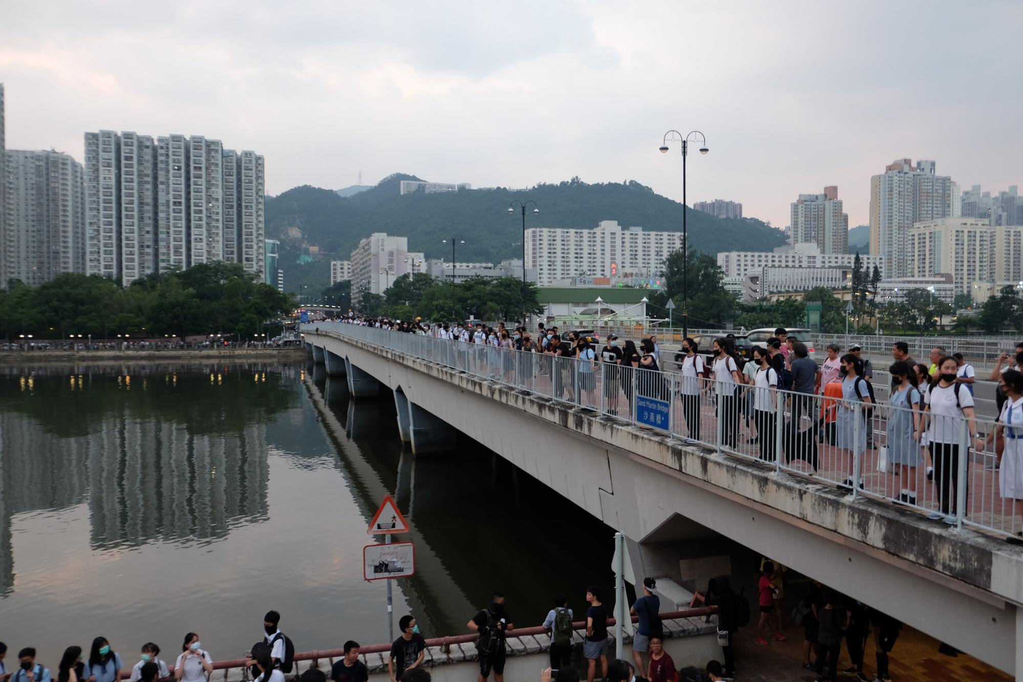 Hundreds of students voluntarily gathered around Shing Mun River to voice their frustration with the Hong Kong government. Picture by Hubert Leong.