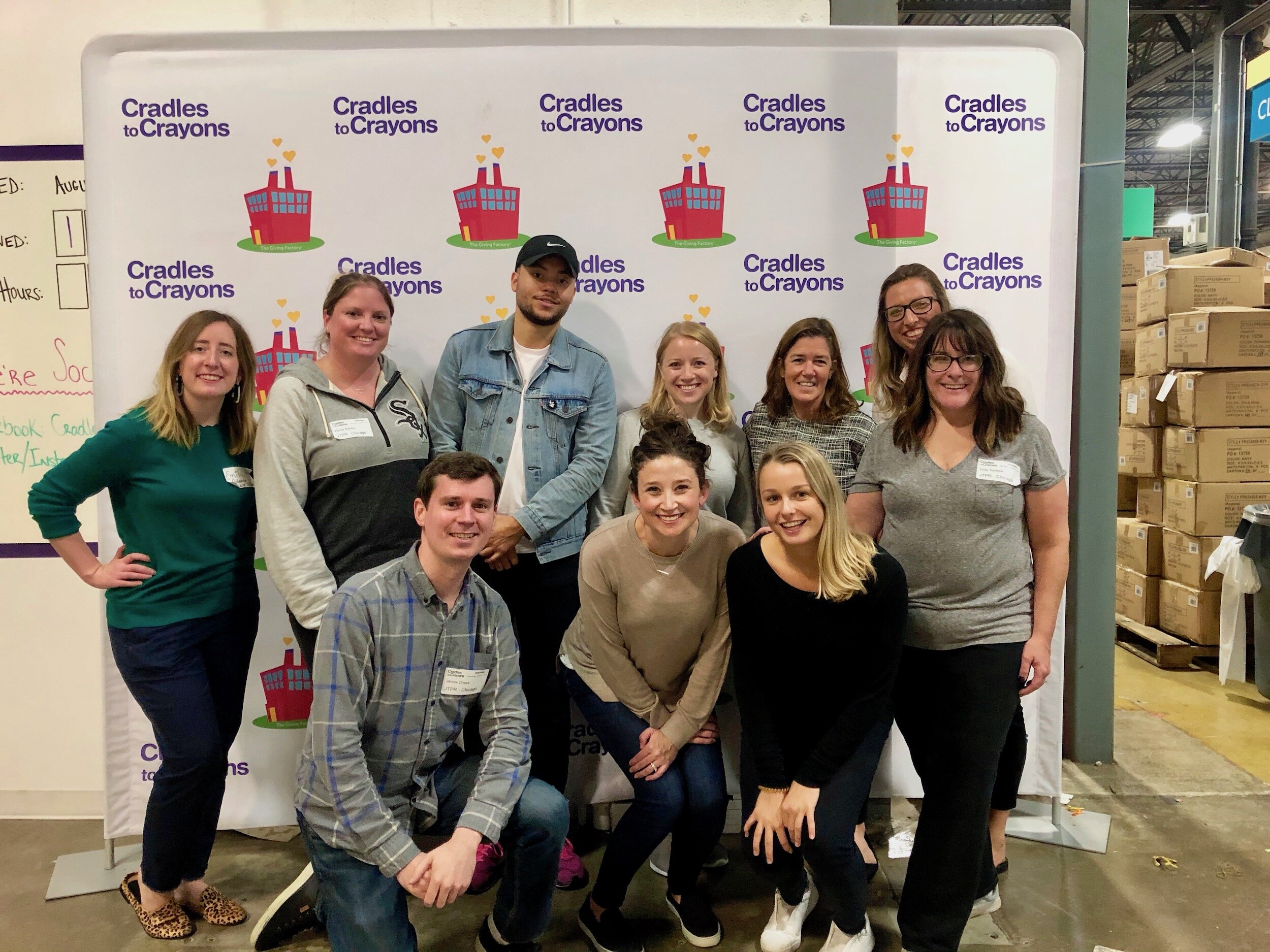 - JT team members volunteer at Cradles to Crayons, a non-profit that provides kids with the essentials they need.