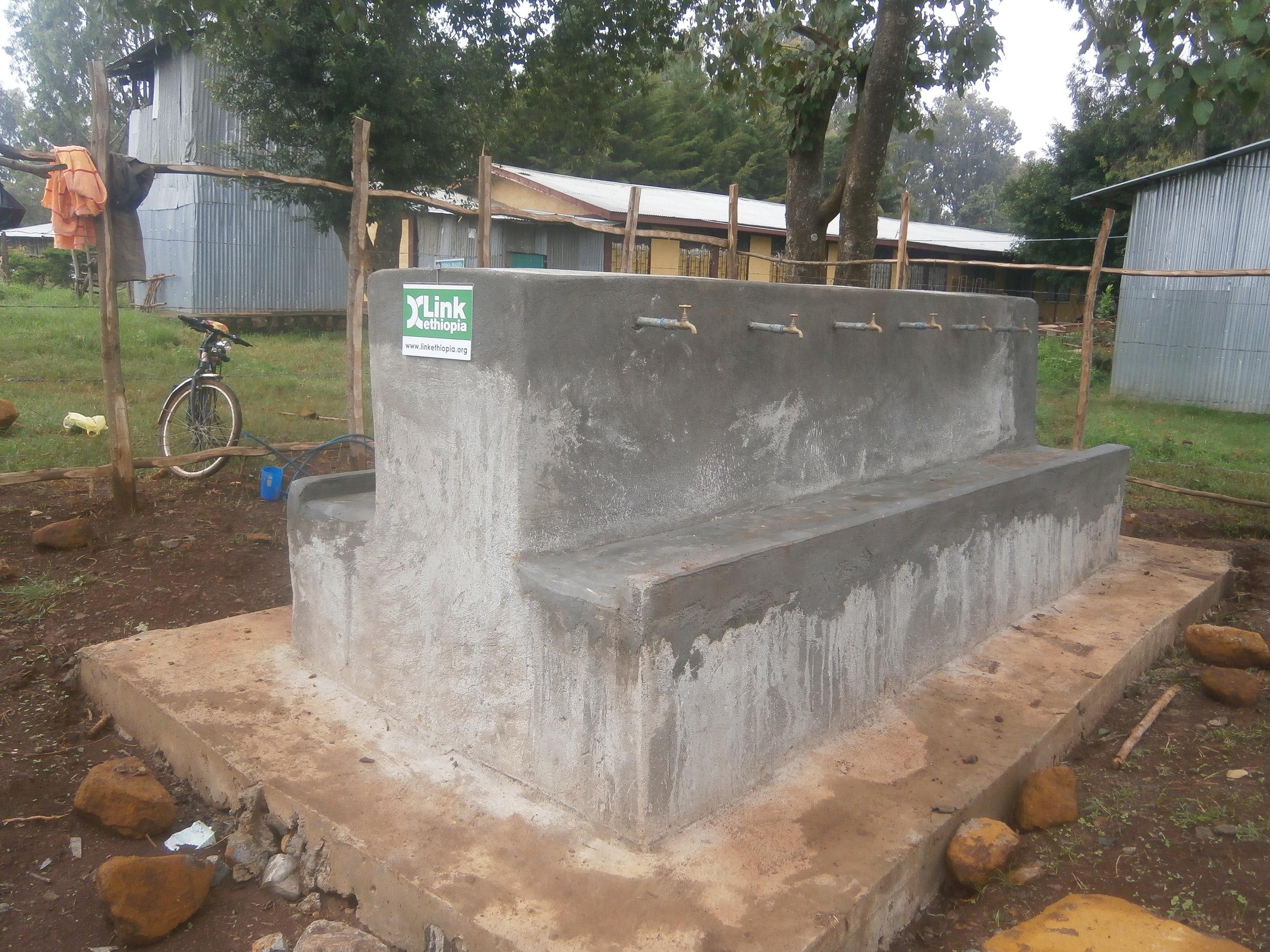 Aykel school 8 tap water station wash.JPG