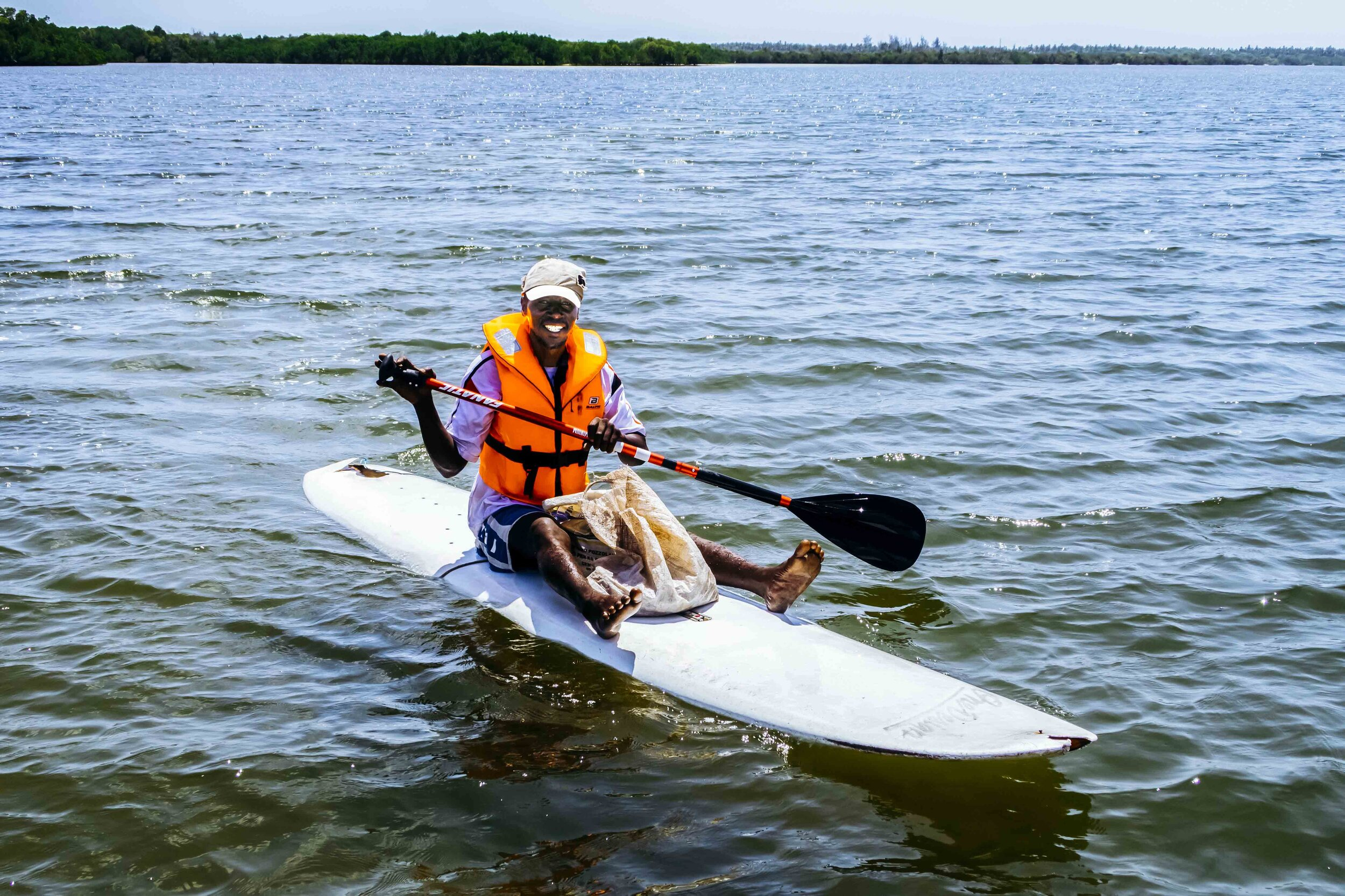 A fisherman in Mida Creek with equipment supplied by Treehouse / Paddle-Bank