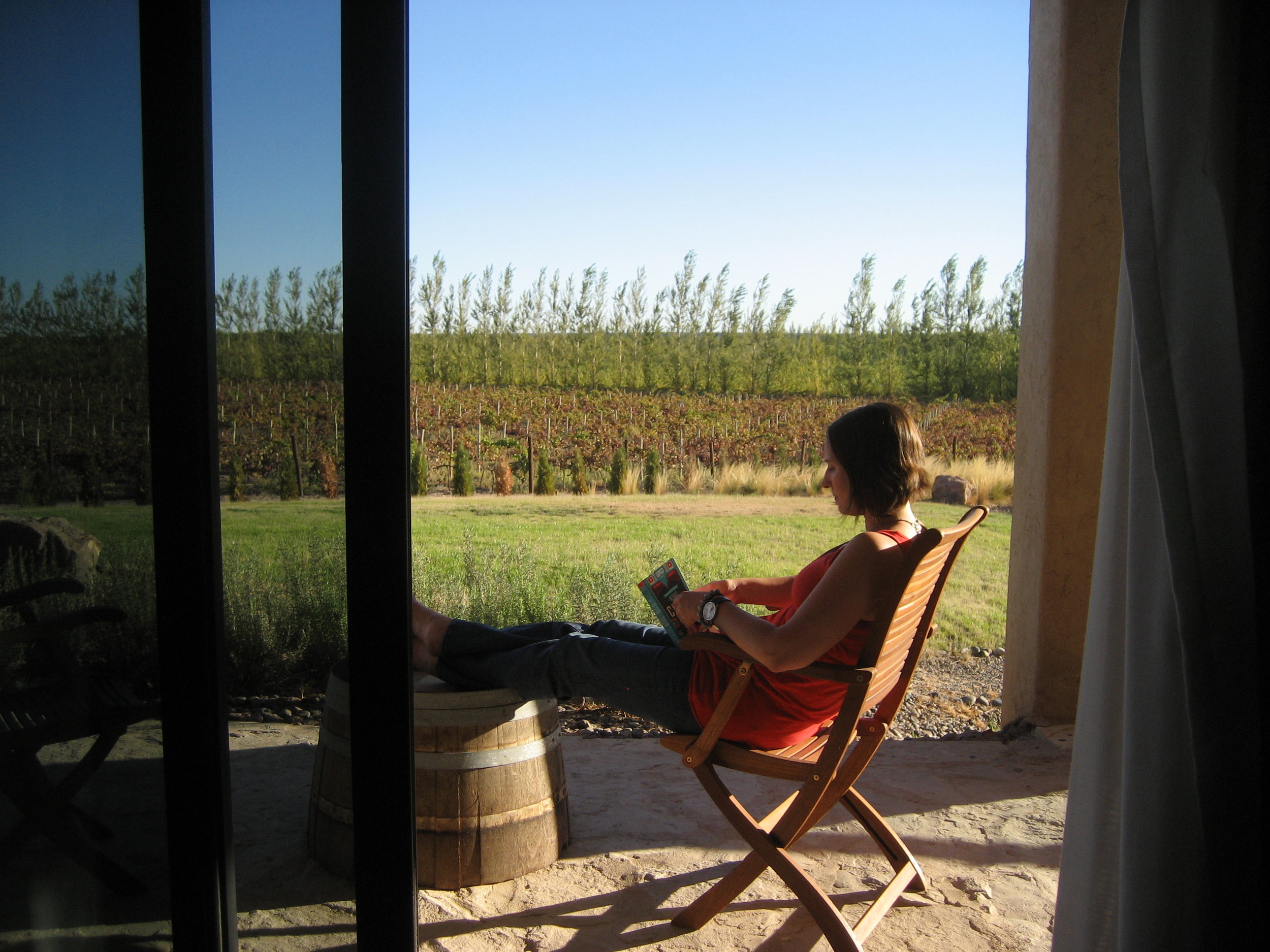 Reading outside my hotel room amongst the vineyards in the Neuquén wine region.