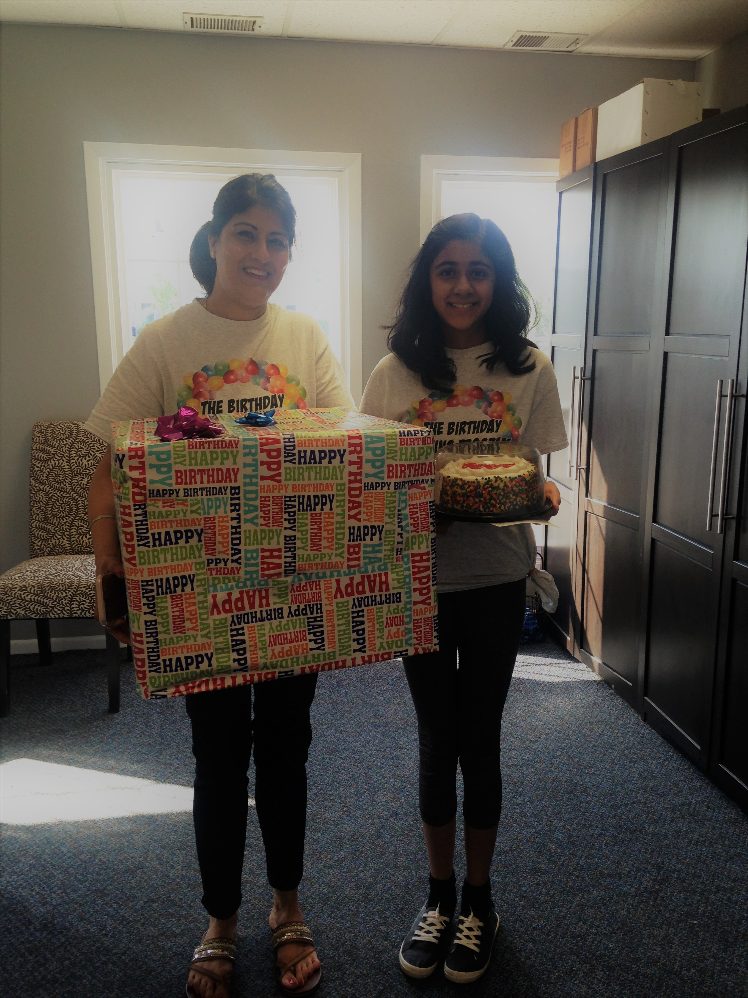 Sonika Menon , right, and her mom Anna with a birthday box
