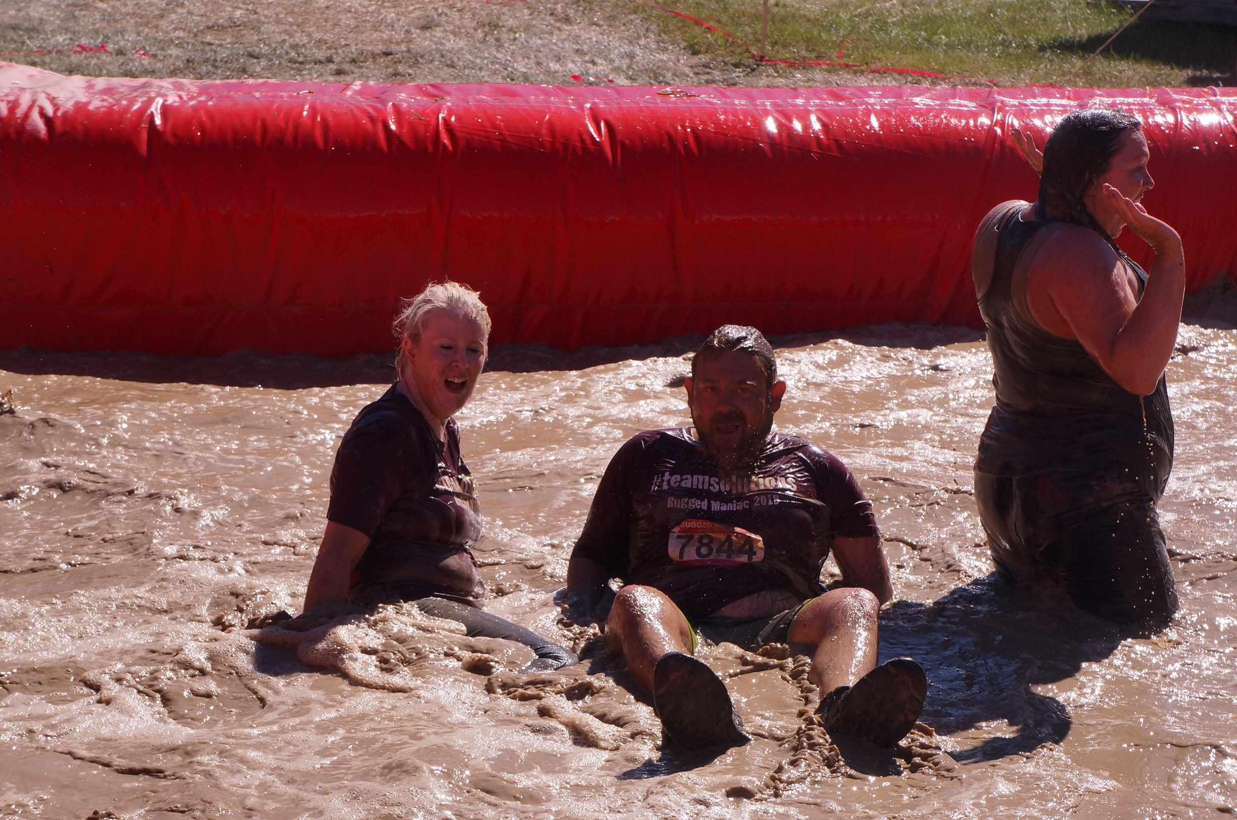 Jessica and Shane in the mud, enjoying themselves.