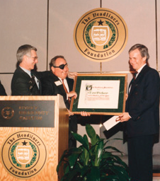 Foundation Governors Neal Spelce and Lowell Lebermann present broadcaster Tom Brokaw with the Headliners of the Year Award in 1992.