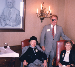 Under the watchful eye of the Ted Read portrait, Lowell Lebermann expresses appreciation to major Foundation donors, Ellen Garwood (left) and Ruth Elliott (right).