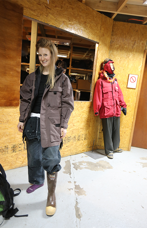 Radio journalist Carolyn Beeler models the steel toed boots needed to work on deck and onshore.