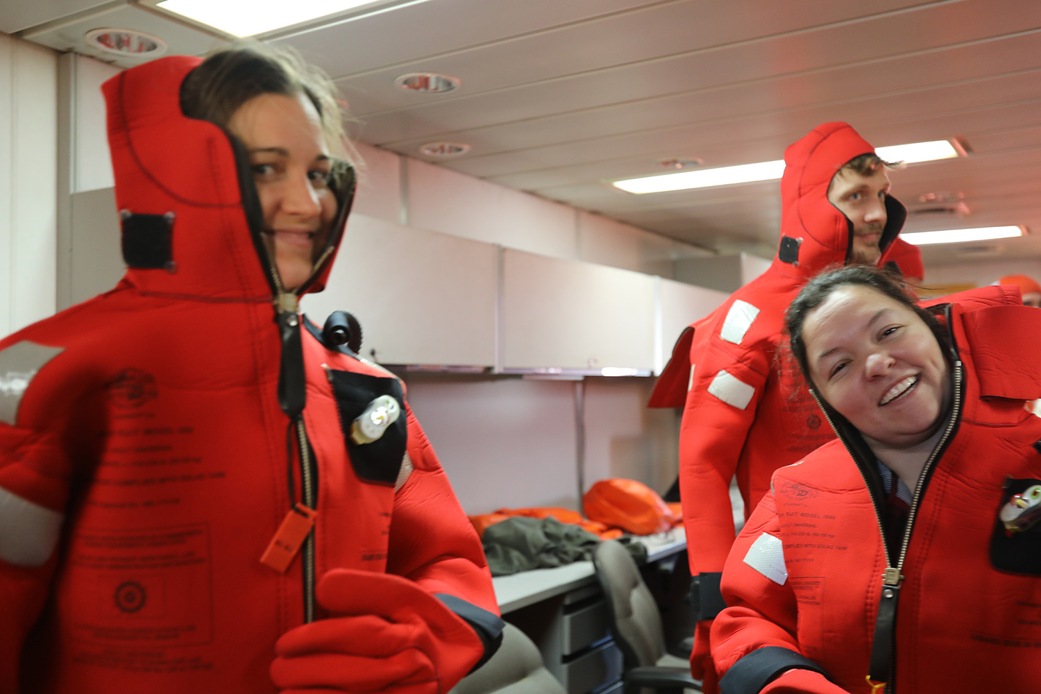 Dr. Rebecca Totten Minzoni (left) and her Ph.D. student Victoria Fitzgerald successfully complete the flotation suit challenge.