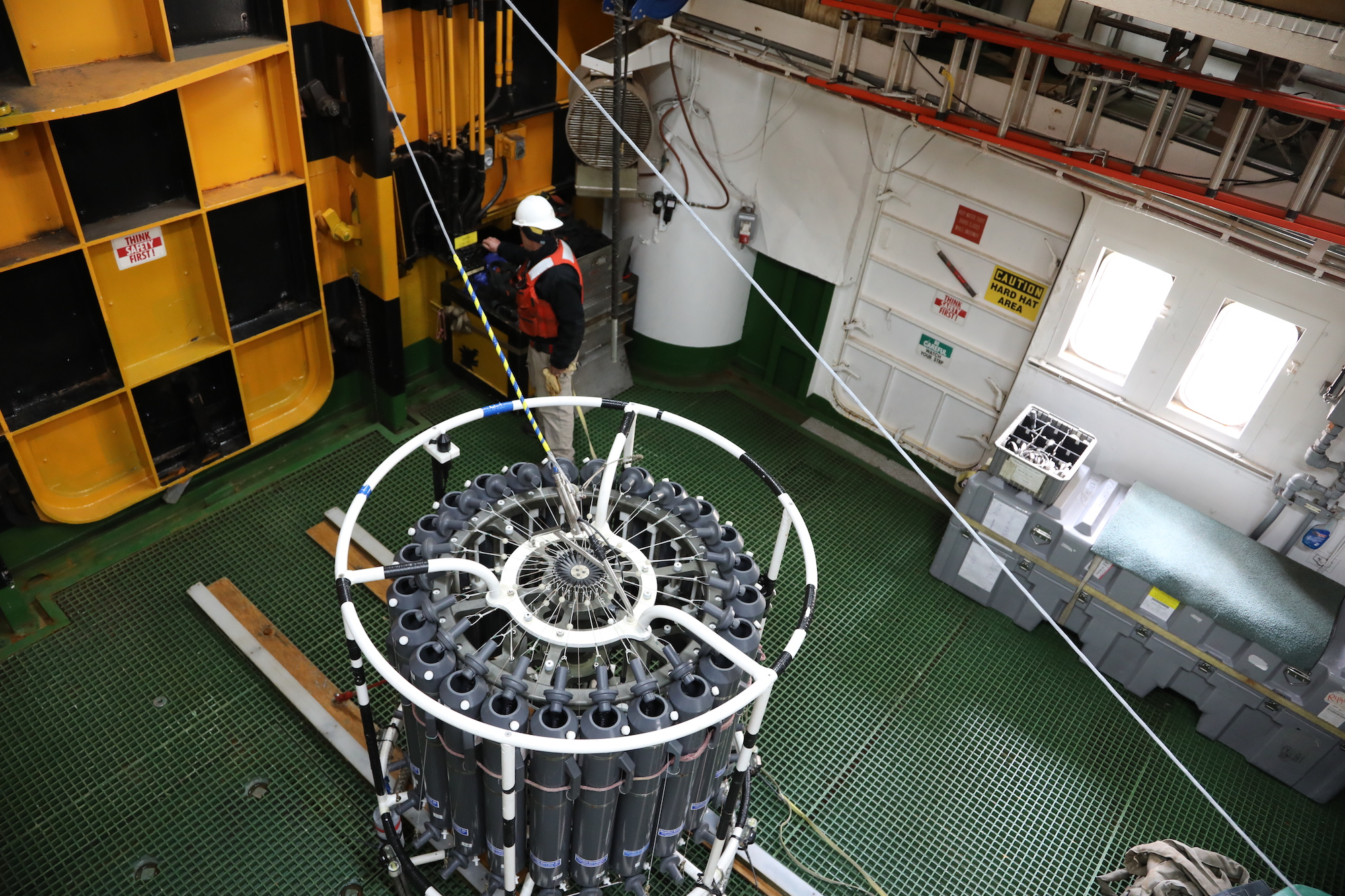 The larger CTD device, also not terribly glamorous, can gather a lot of data in real time, if only in one spot. Its sensors send the information to a computer on the ship all during its trip to the deep. The large gray cannisters are like giant test tubes that can be signaled to open during its passage, sampling the ocean water. Samples can then be used to measure things like chlorophyll (the amounts of which can serve to tell scientists how well the phytoplankton are doing) oxygen in the water. They can also be preserved for future science that will be conducted at land-based laboratories following the cruise. The profiles provided by CTD's have wide application for ocean modeling.  for THOR, the temperature and salinity profiles are used as part of calculating the sound velocity that provides the multibeam sea floor bathymetry data.