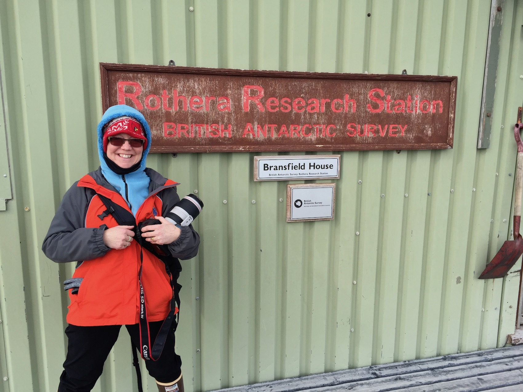 A sign for the Rothera Station, with one Linda Welzenbach for scale.