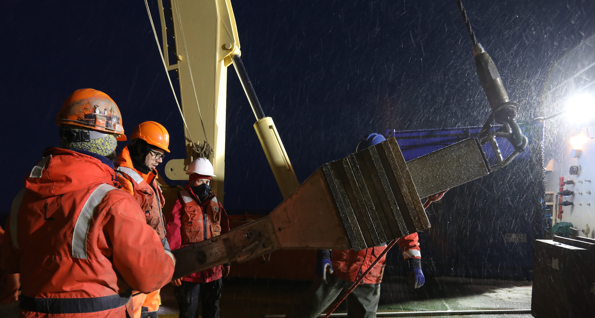 Night coring using the Kasten corer. The wire holds the top of the corer at an angle to allow the THOR team to put spacers into the top of the core. Just below where the wire is connected to the top of corer are the weights that help force the barrel down into the sea floor.