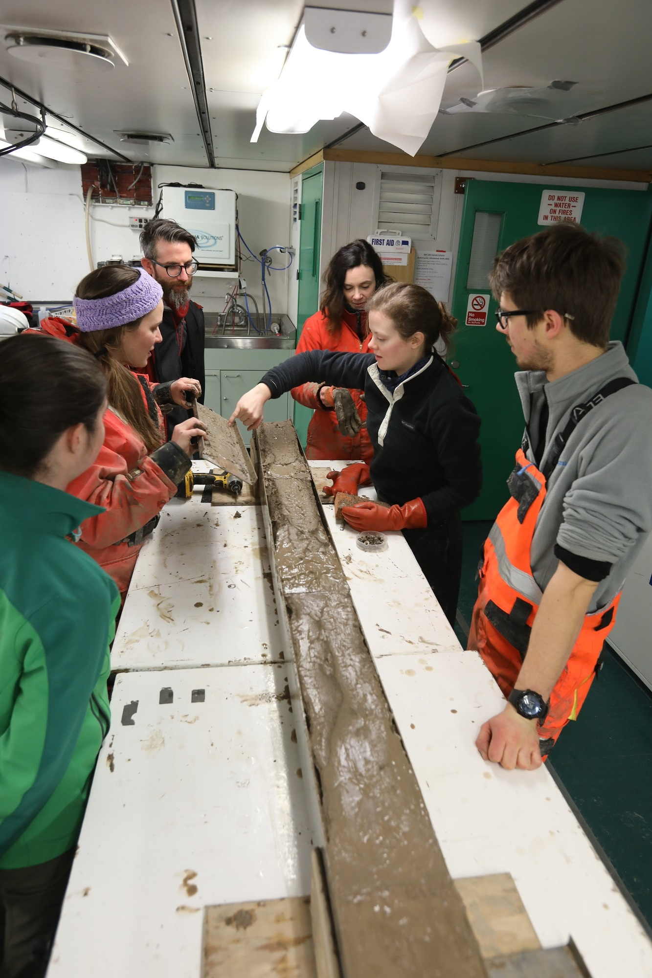 Meghan Spoth (M.S. student from the University of Maine who is with GHC) and the THOR team get their first look at a Kasten core that was collected at night (see Hammertime).