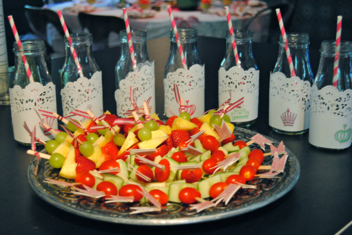 """I took frapuccino bottles and covered them in doilies and glitter stickers. You cannot get more girly than this! Fruit skewers and vegi/cheese skewers for the """"healthy platter."""""""