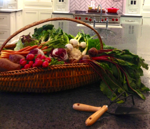 """A basket that says, """"We just came in from the garden with nature's bounty!"""""""