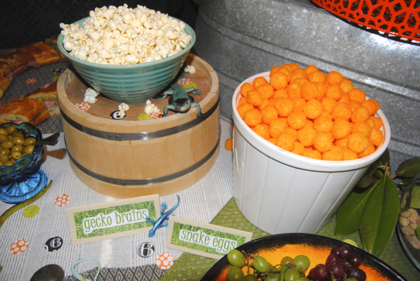 Gecko Brain popcorn and Snake Egg cheese puffs. She was insistent that these be on the menu!