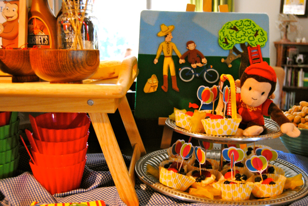 Fruit tarts with balloons, vintage CG felt board and George himself!