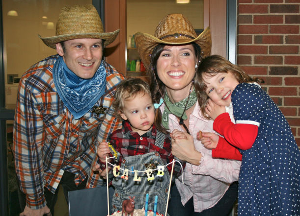 Our lil family has a 2 year old! I decorated a blue layer cake with white icing and red hots. I tied twine around 2 skewers and attached the letters of his name above a horse and candles! Easy as pie, er, cake.