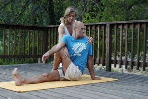 Yoga instructor with guest