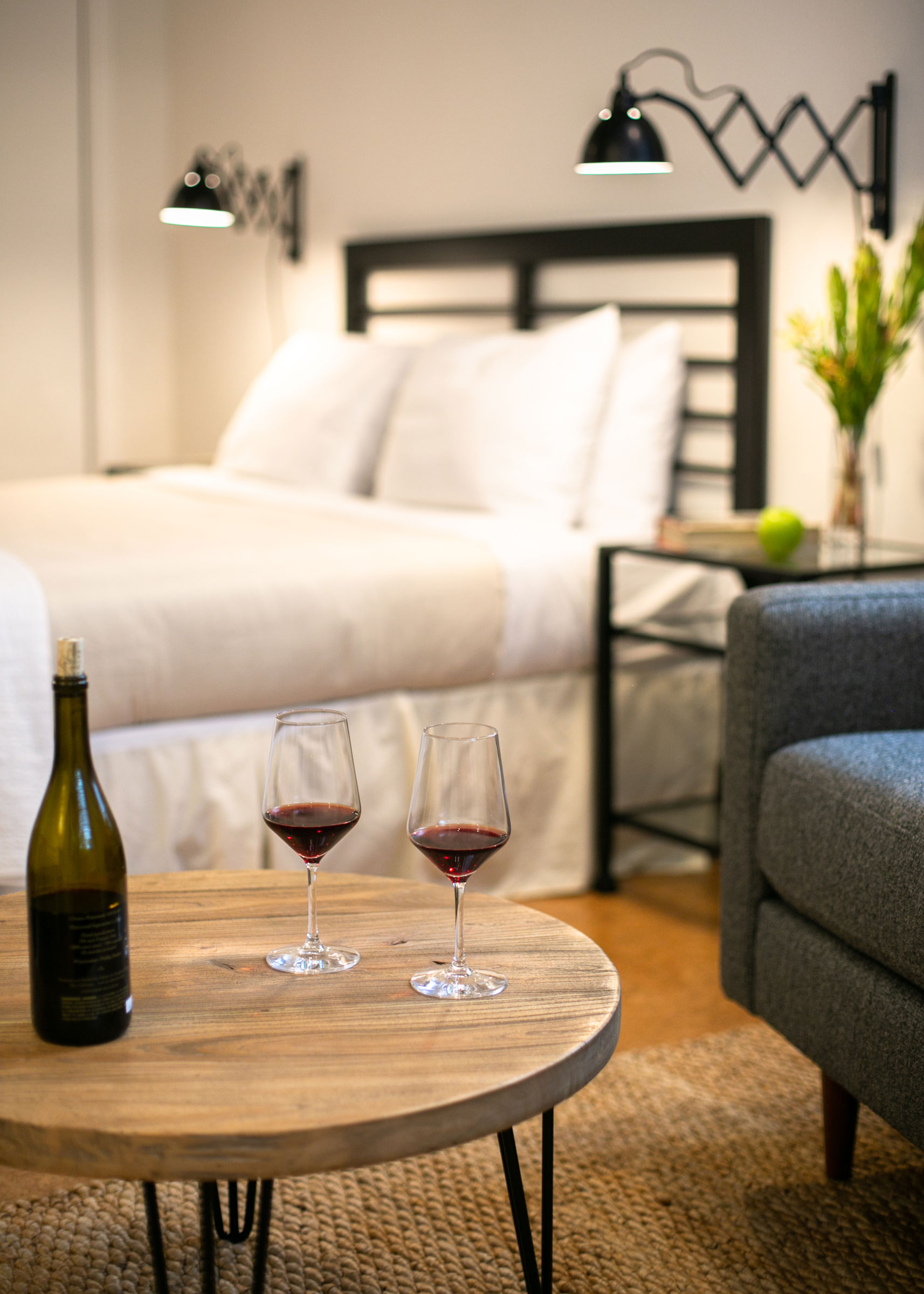 Two glasses of red wine await guests in room 104 at The Lodge at Glendeven Inn & Lodge