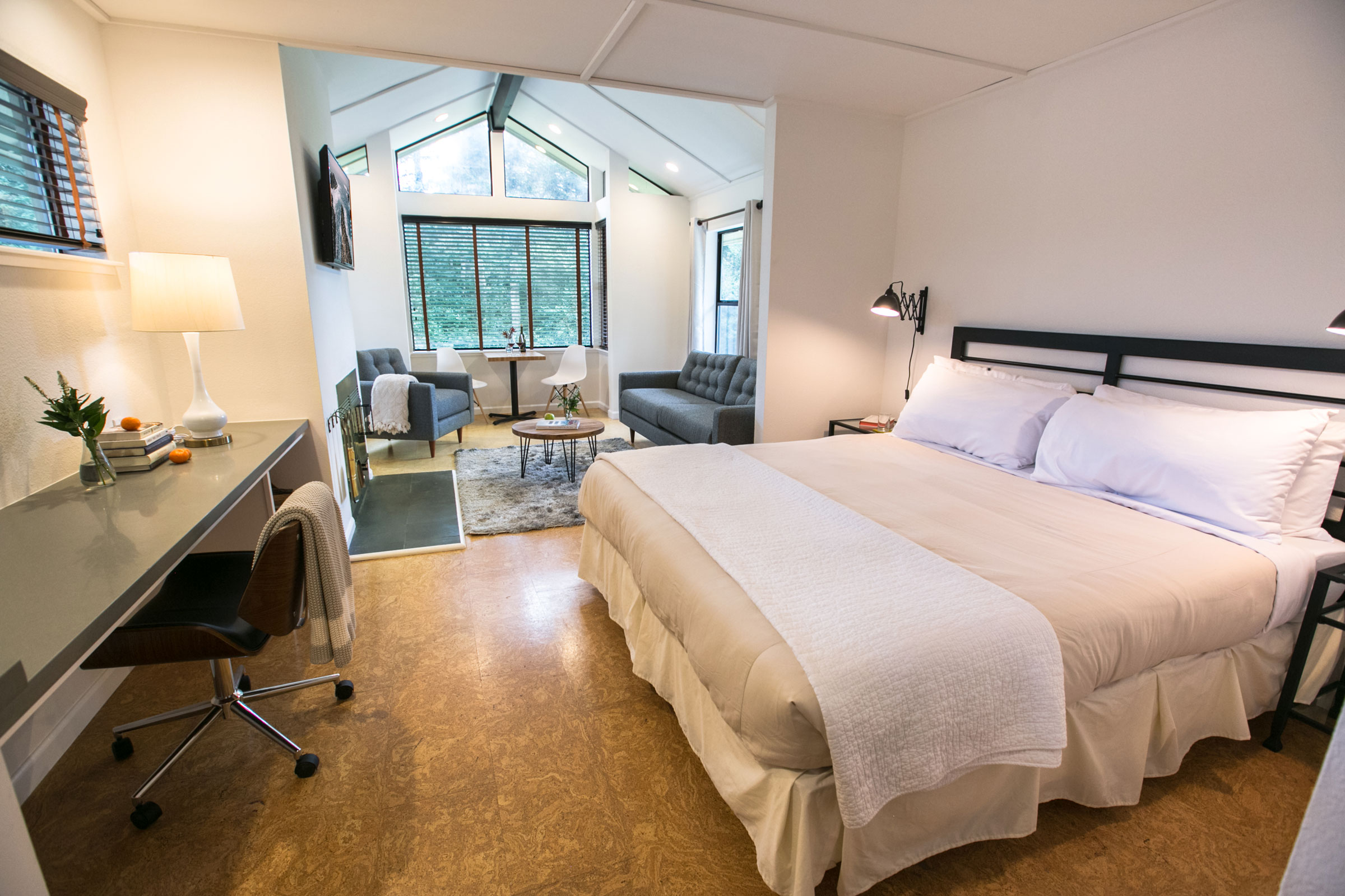 The spacious queen bed in room 203 at the Lodge at Glendeven outside Mendocino, as well as sitting area and work station.