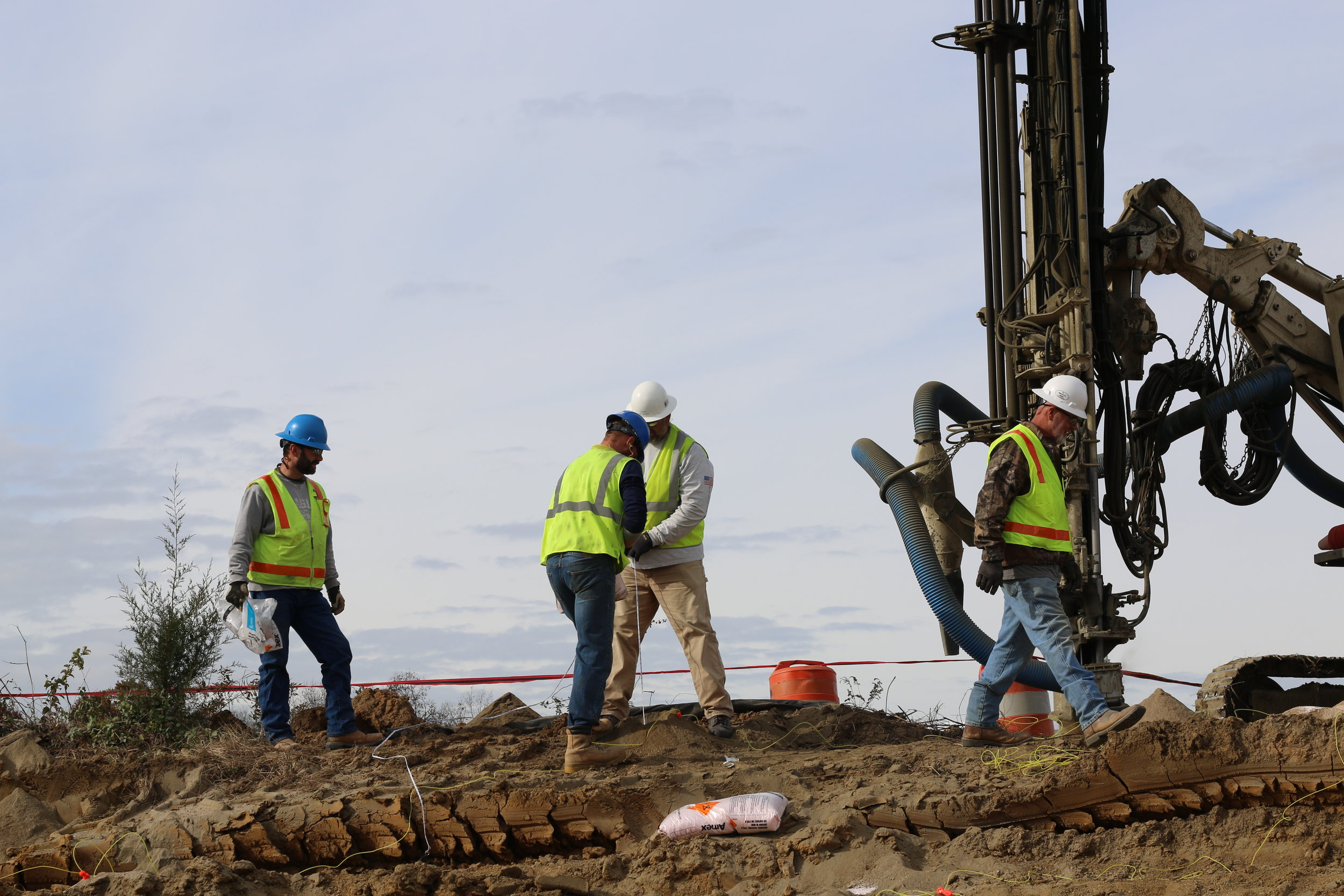 workers preparing a controlled blast project site