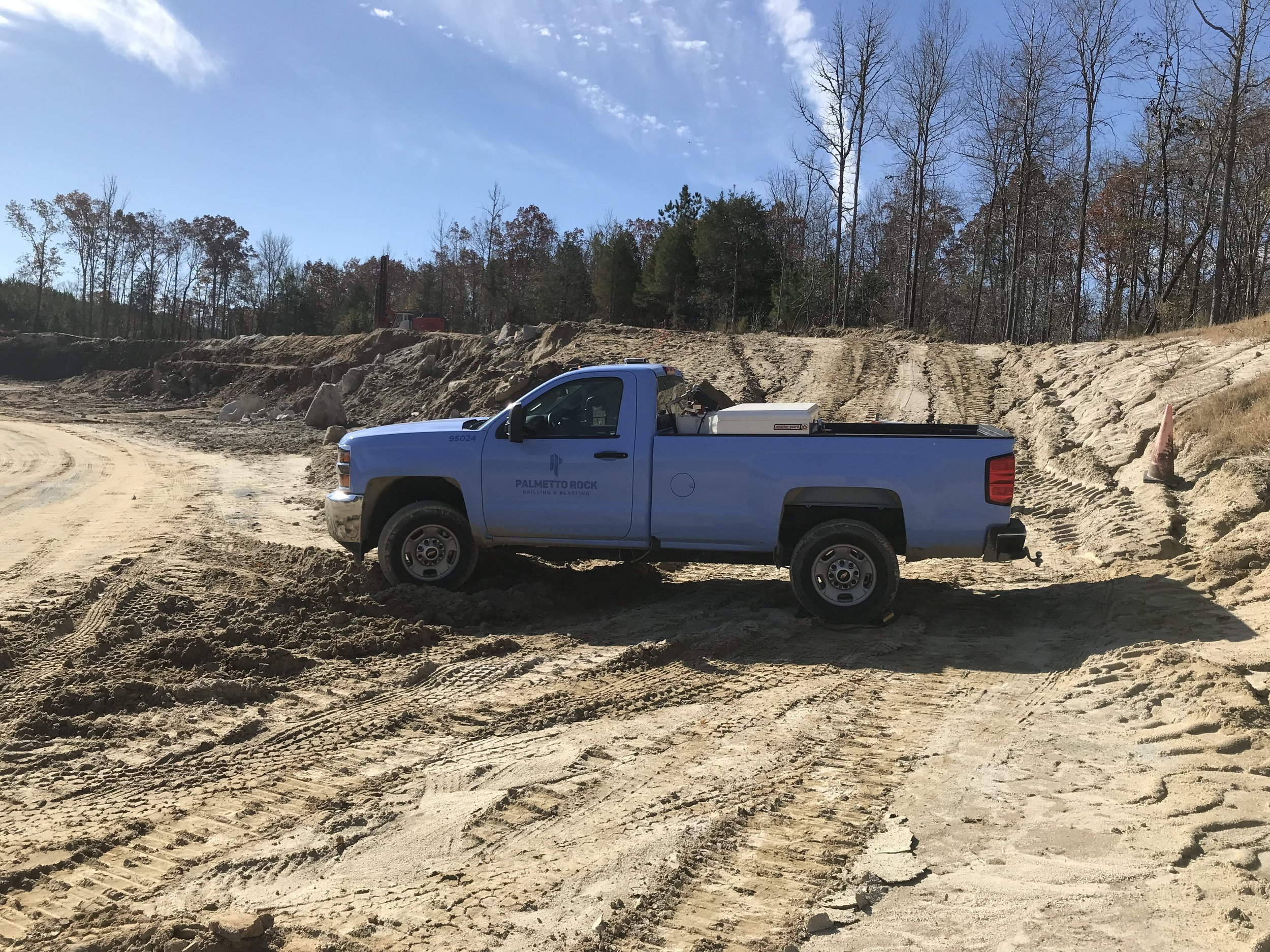 pickup truck in the dirt at a project site