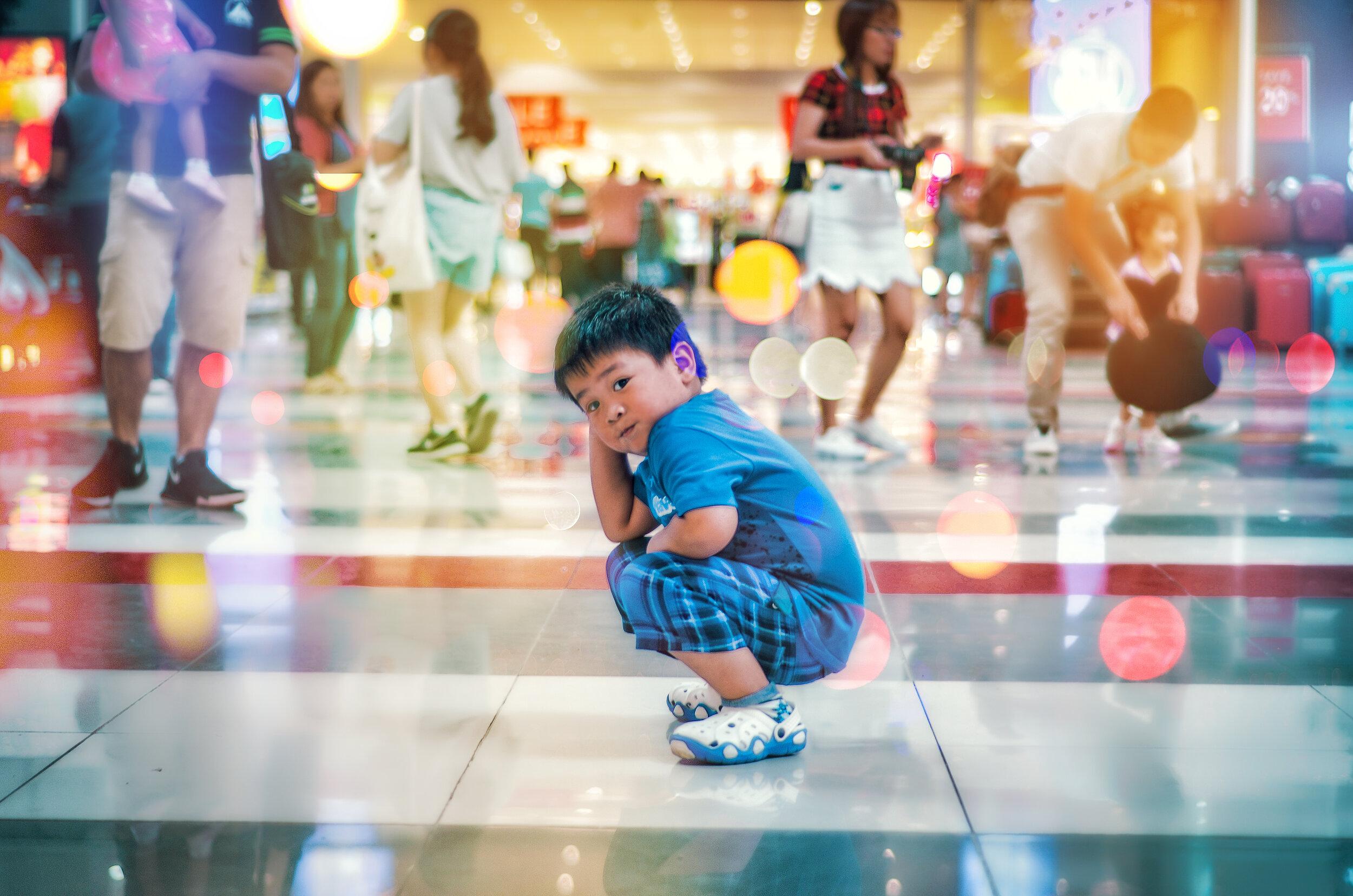 Canva - Boy Squating on White Floor Tile.jpg