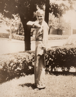 My father (at 18), Drew Wilson, showing off his private stripe, on leave from basic training, at home in Columbus Ohio in late summer of 1943.