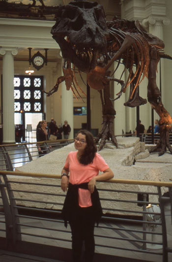 "Elena in front of the skeleton of a Tyrannosaurus Rex nicknamed ""Sue"", in the Field Museum."